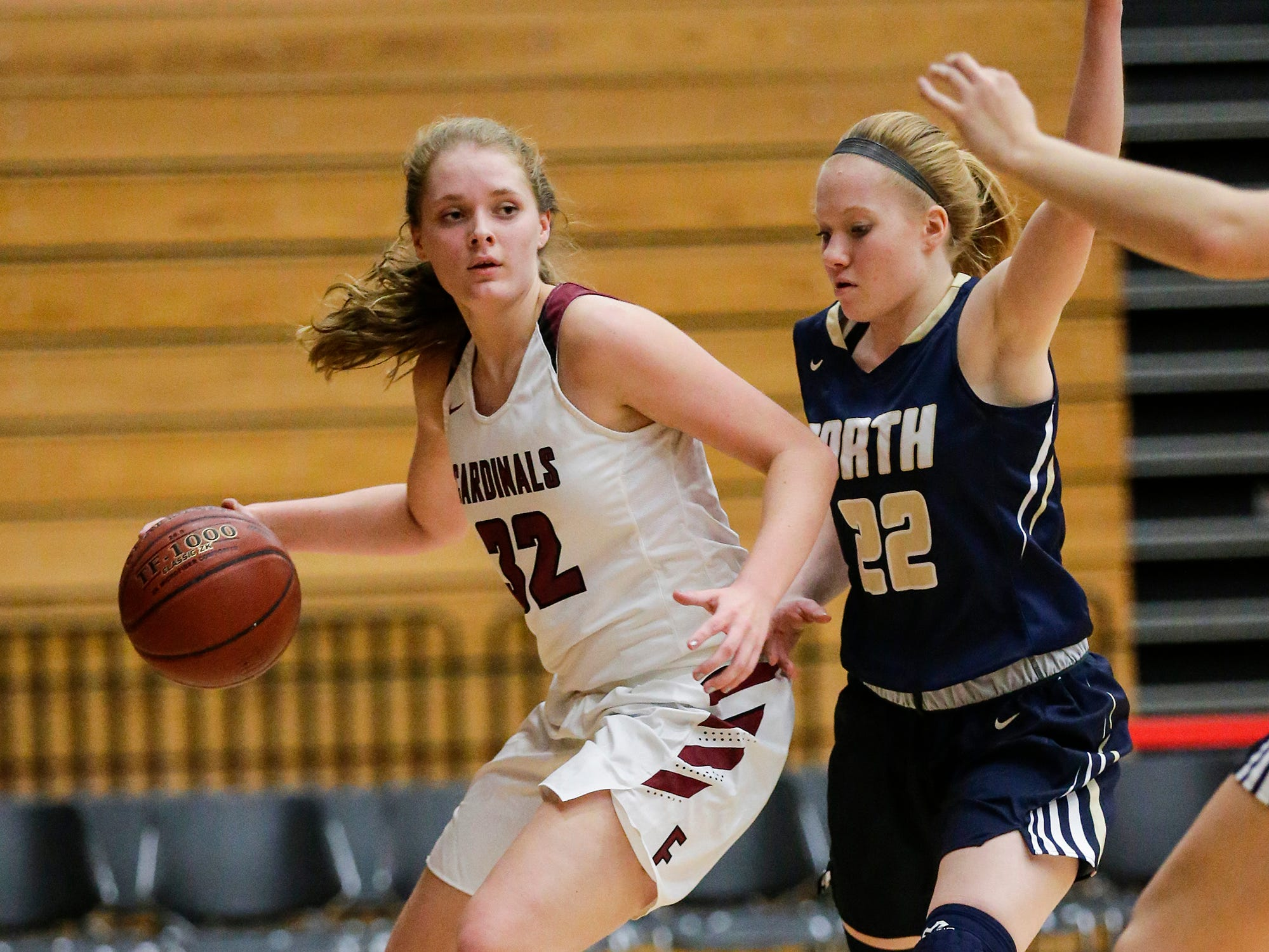 Fond du Lac High School girls basketball's Breanna Miller works her way past Appleton North High School's Kayla Schroeder during their game Tuesday, Dec. 4, 2018 in Fond du Lac, Wisconsin.