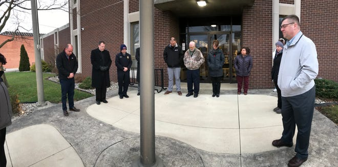 City officials and the public celebrate the late President George H.W. Bush with a moment of silence and prayer Wednesday morning during the national day of mourning.