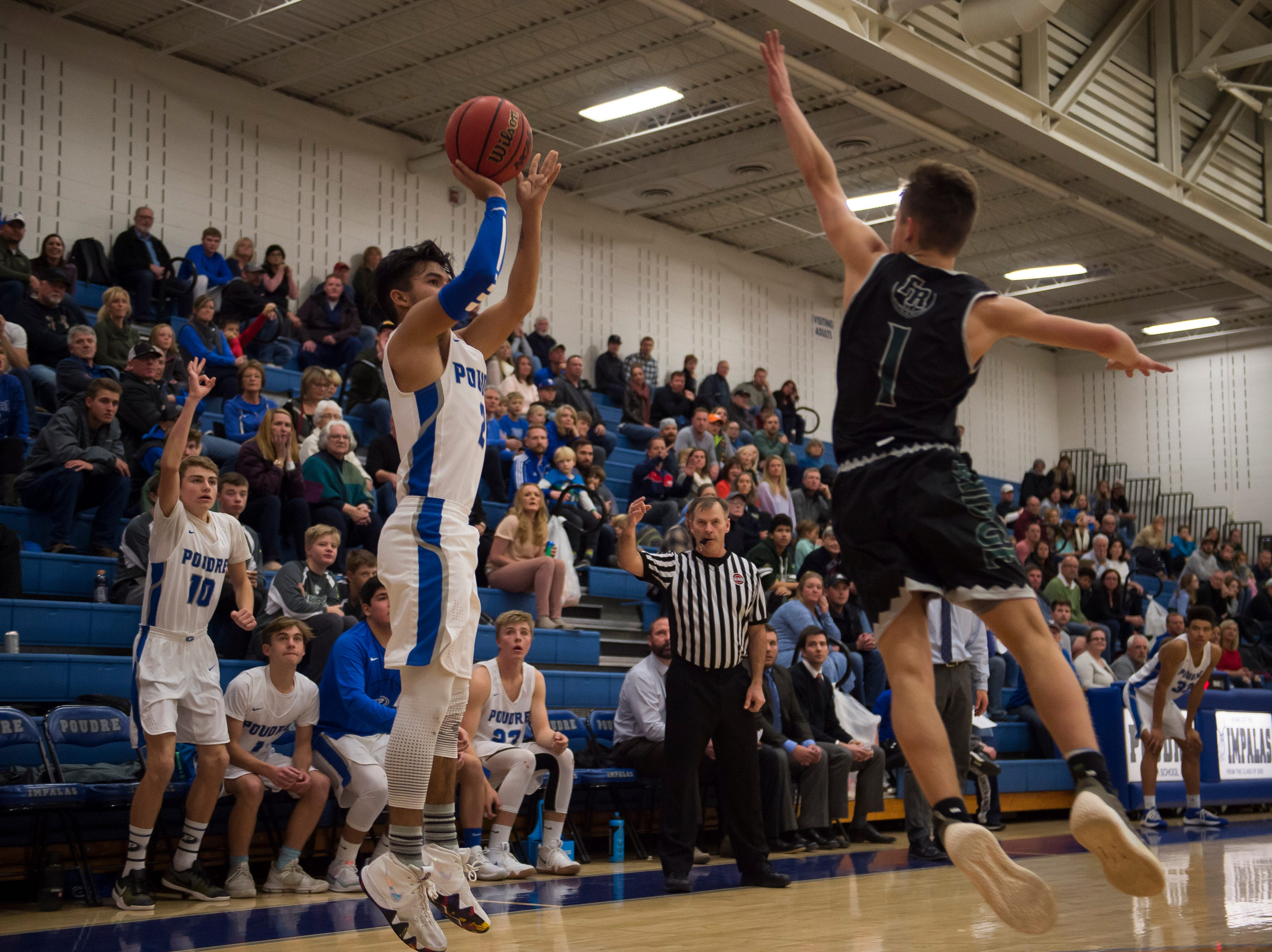 Poudre High School junior Sergio Tarango (2) puts up a three during a game against Fossil Ridge High School on Tuesday, Dec. 4, 2018, at Poudre High School on Fort Collins, Colo.