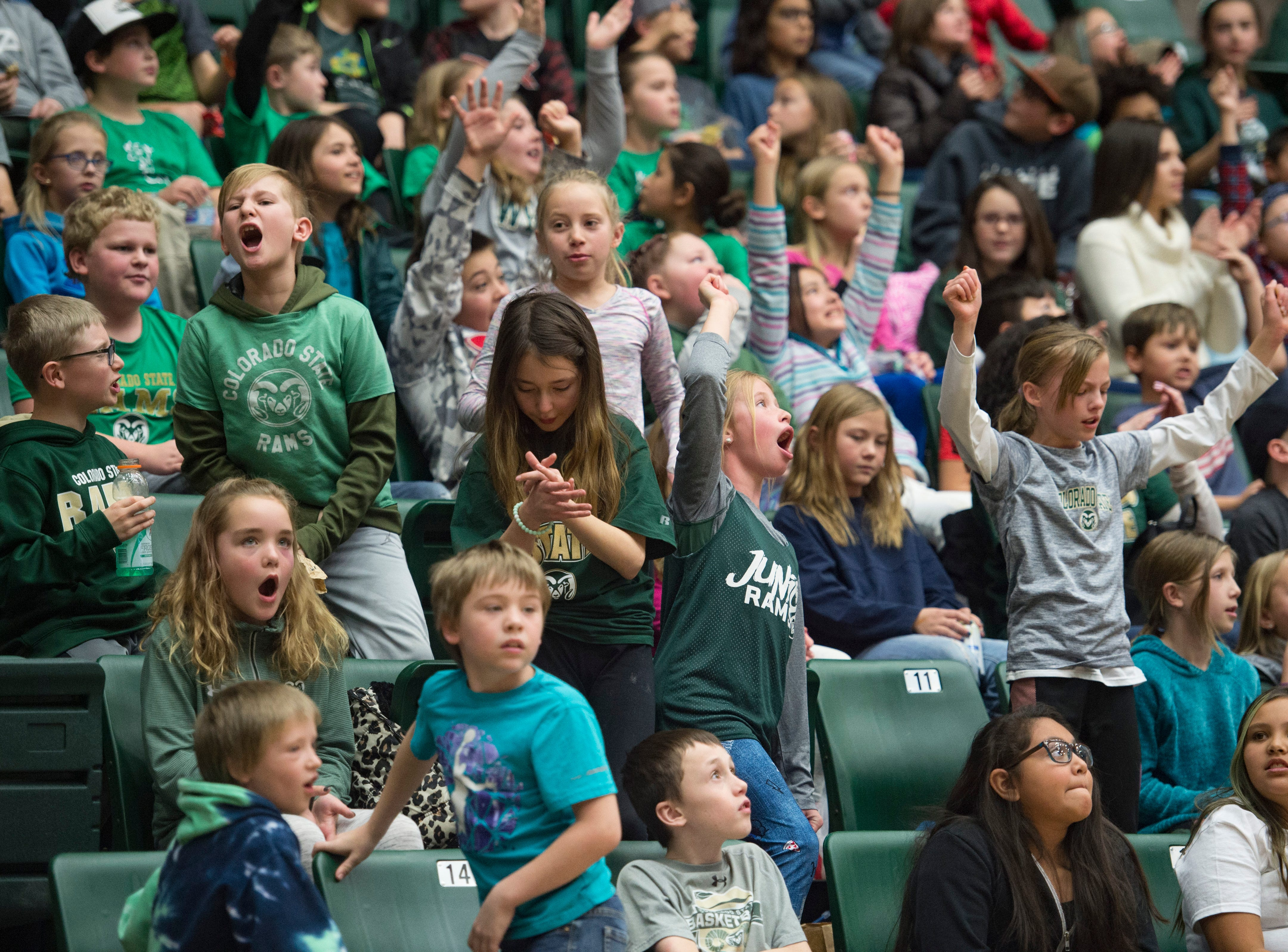 Elementary school students cheer as they support the CSU women's basketball team as they took on Northern Arizona at Moby Arena on Wednesday, December 5, 2018.