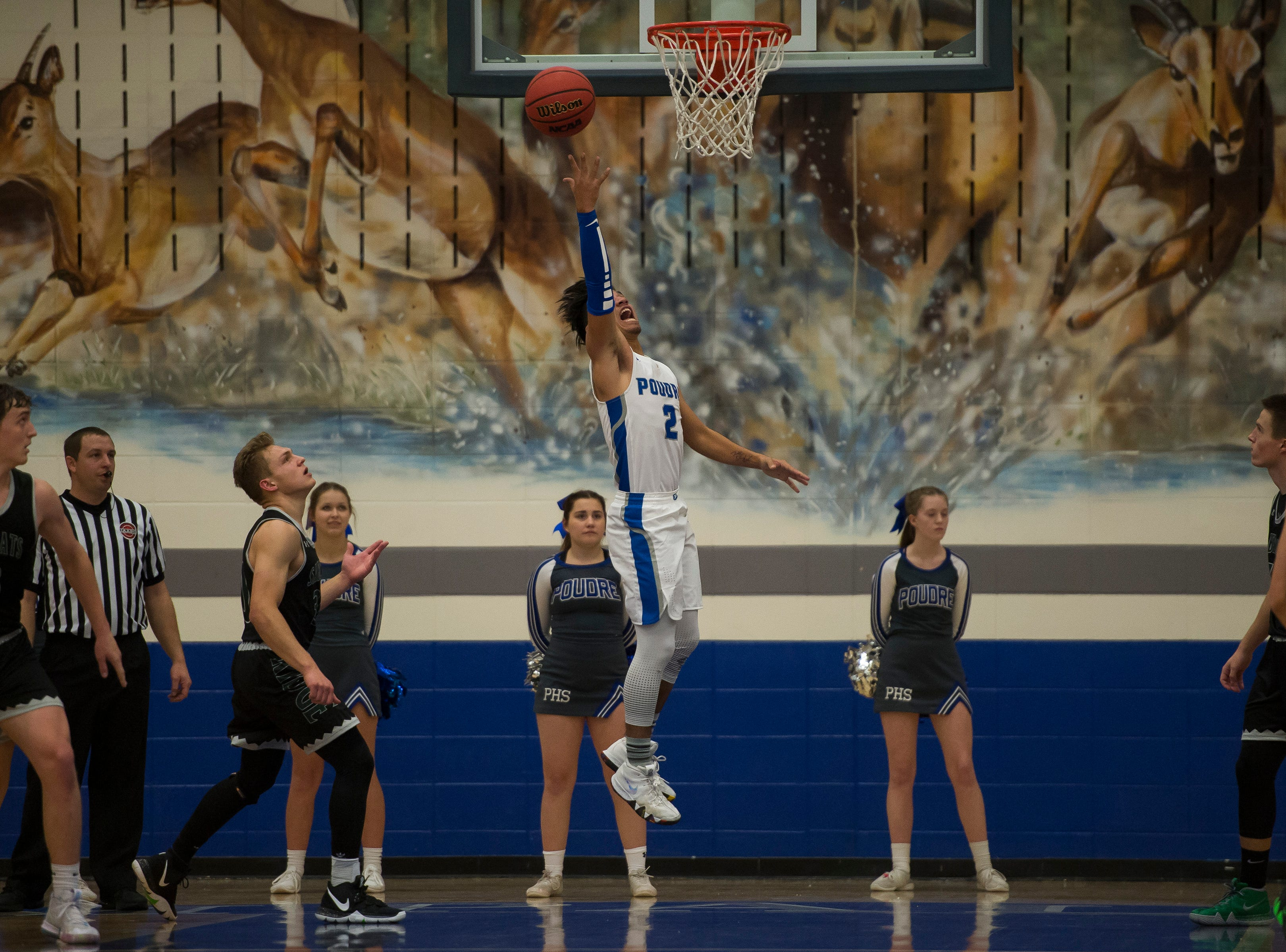 Poudre High School junior Sergio Tarango (2) puts up a layup during a game against Fossil Ridge High School on Tuesday, Dec. 4, 2018, at Poudre High School on Fort Collins, Colo.