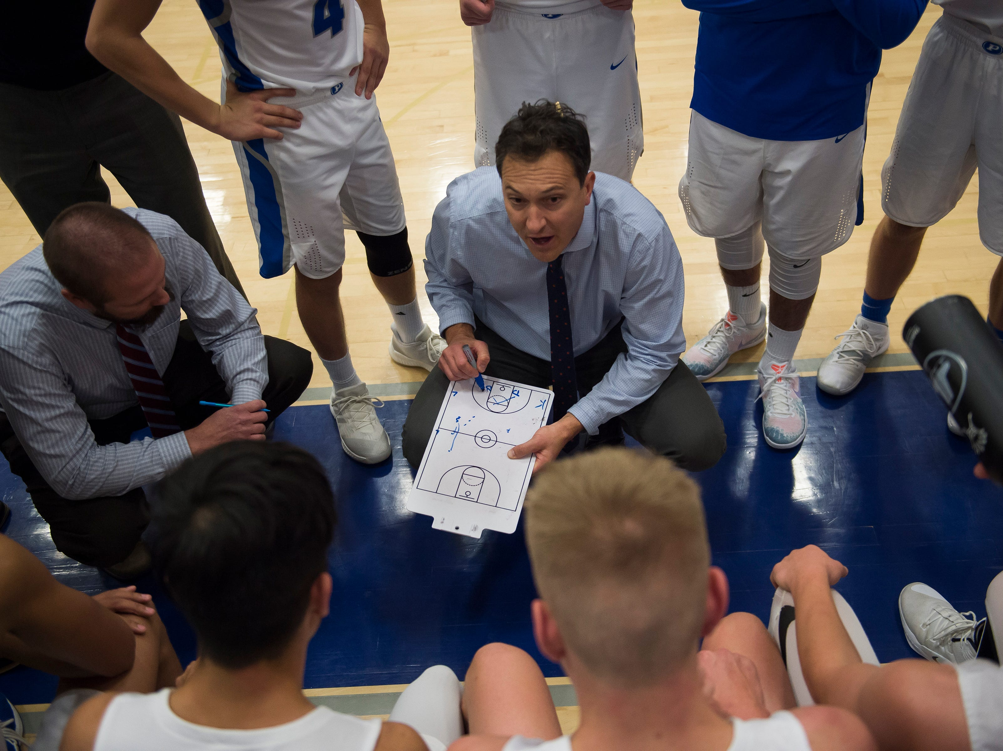 Poudre High School head coach Jacob Stein strategizes with his team during a game against Fossil Ridge High School on Tuesday, Dec. 4, 2018, at Poudre High School on Fort Collins, Colo.