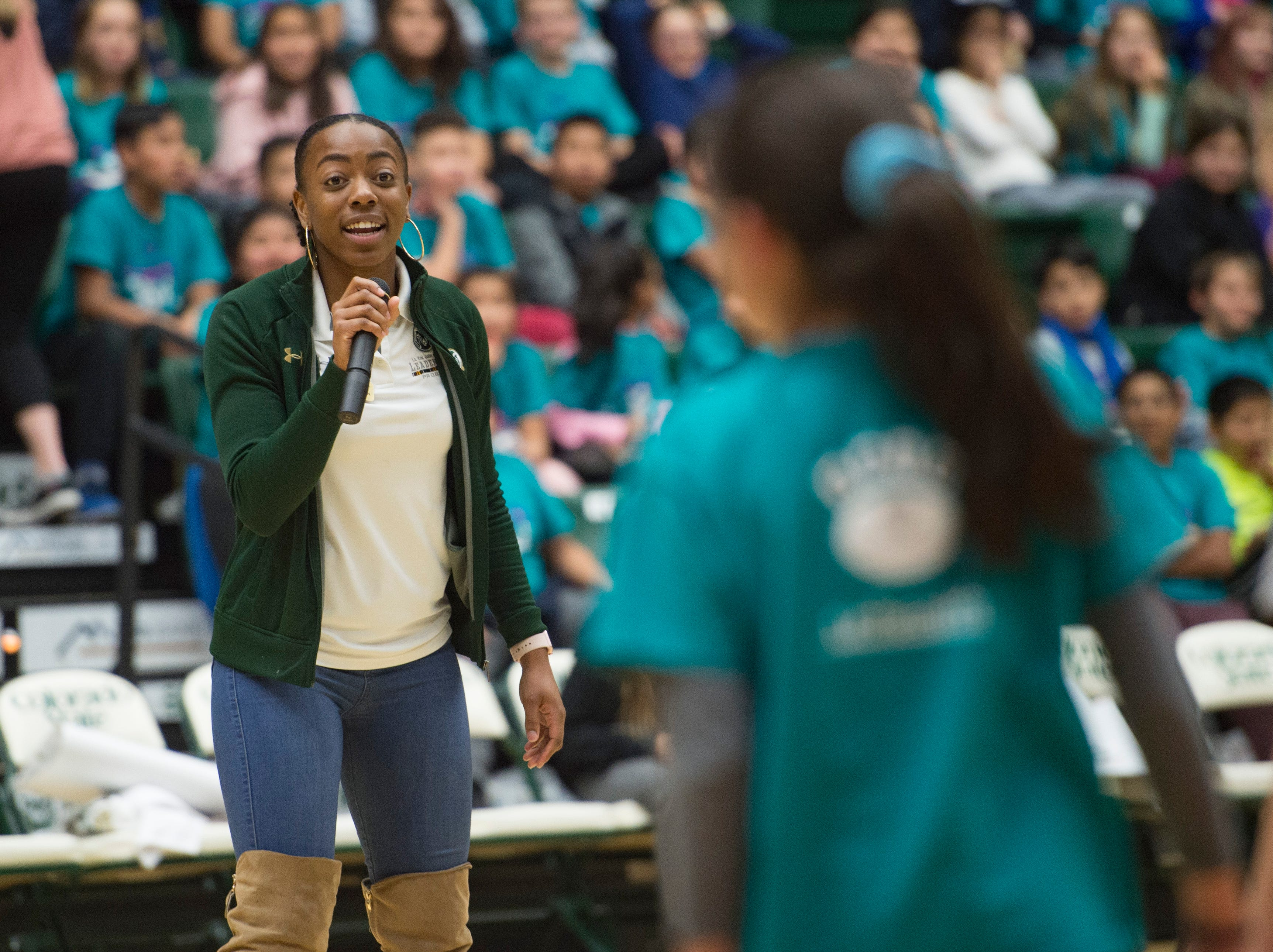 CSU Track's Lorenda Holston leads a group of Poudre School District students in a game of Simon Says during halftime of a women's basketball game against Northern Arizona at Moby Arena on Wednesday, December 5, 2018.