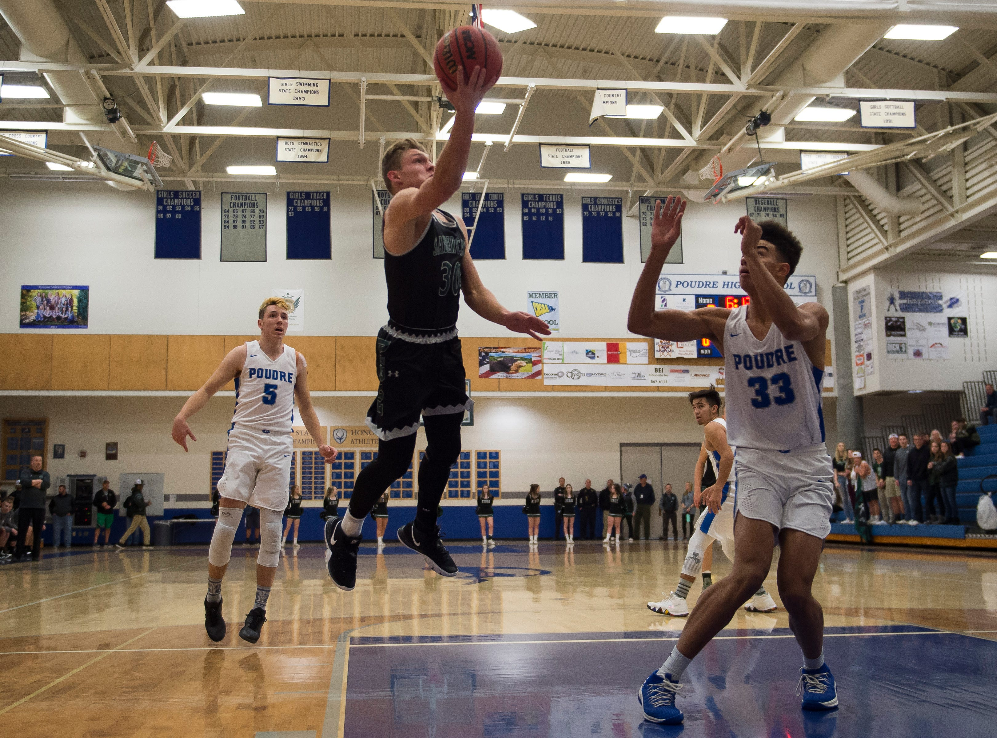 Fossil Ridge High School senior Zack Crane attempts a layup during a game against Poudre High School on Tuesday, Dec. 4, 2018, at Poudre High School on Fort Collins, Colo.