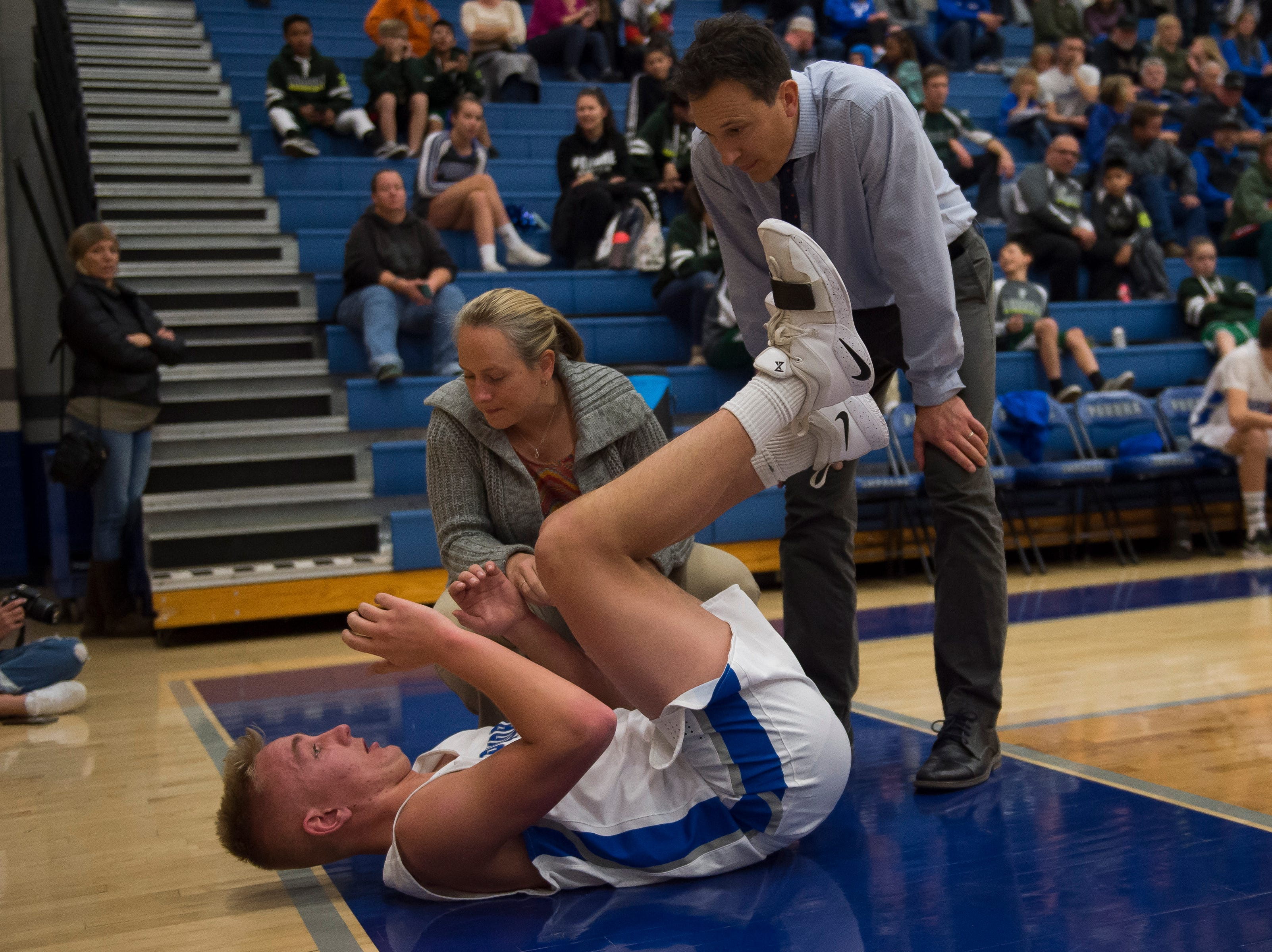 Poudre High School senior Jack Fisher (55) pops back up after going down in a game against Fossil Ridge High School on Tuesday, Dec. 4, 2018, at Poudre High School on Fort Collins, Colo.