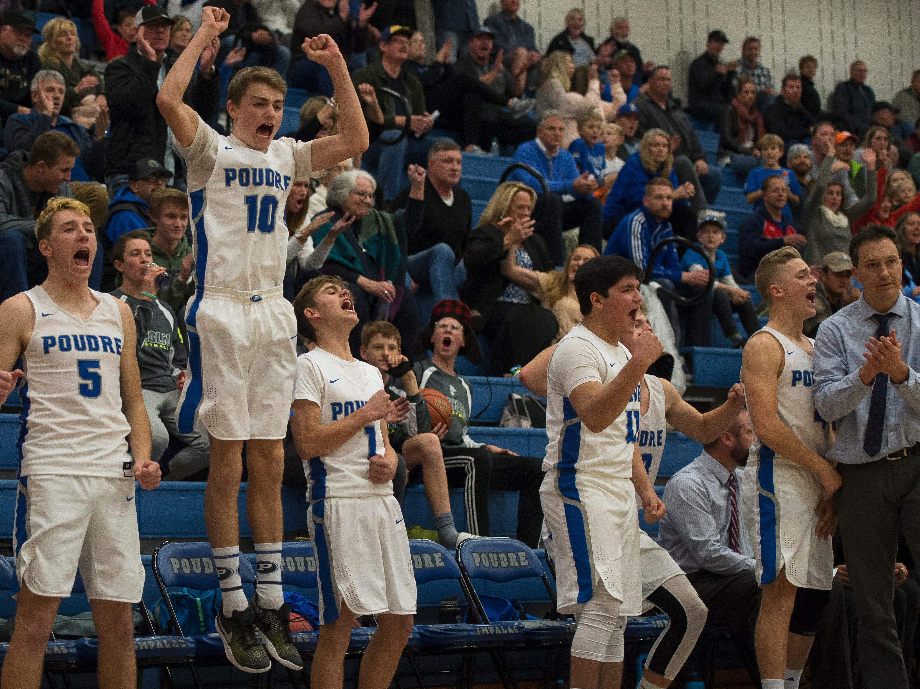 Poudre High School players react from the bench in the waning minutes of a win over Fossil Ridge High School on Tuesday, Dec. 4, 2018, at Poudre High School on Fort Collins, Colo.