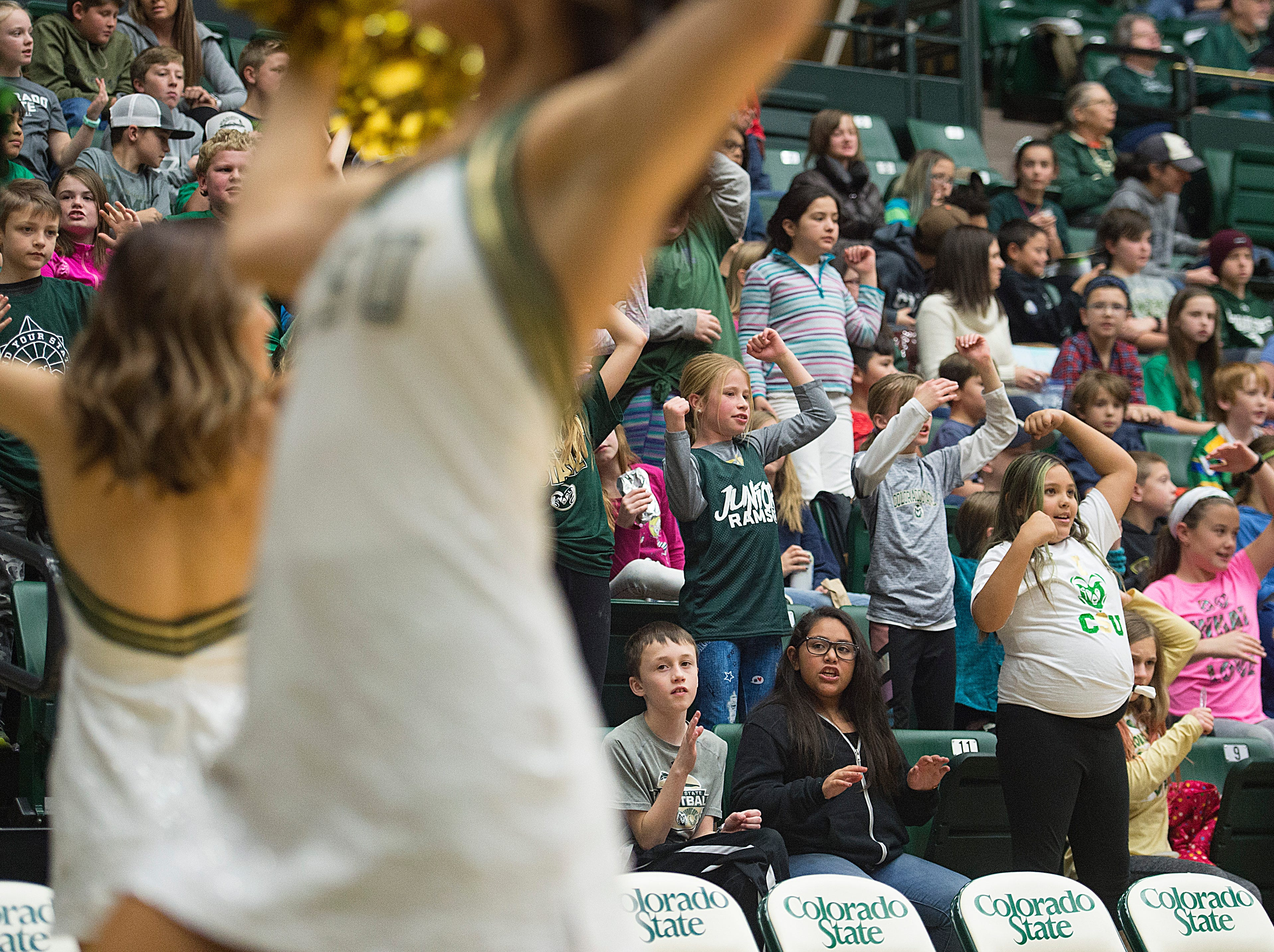 Elementary school students follow along with CSU cheerleaders during a women's basketball game against Northern Arizona at Moby Arena on Wednesday, December 5, 2018.