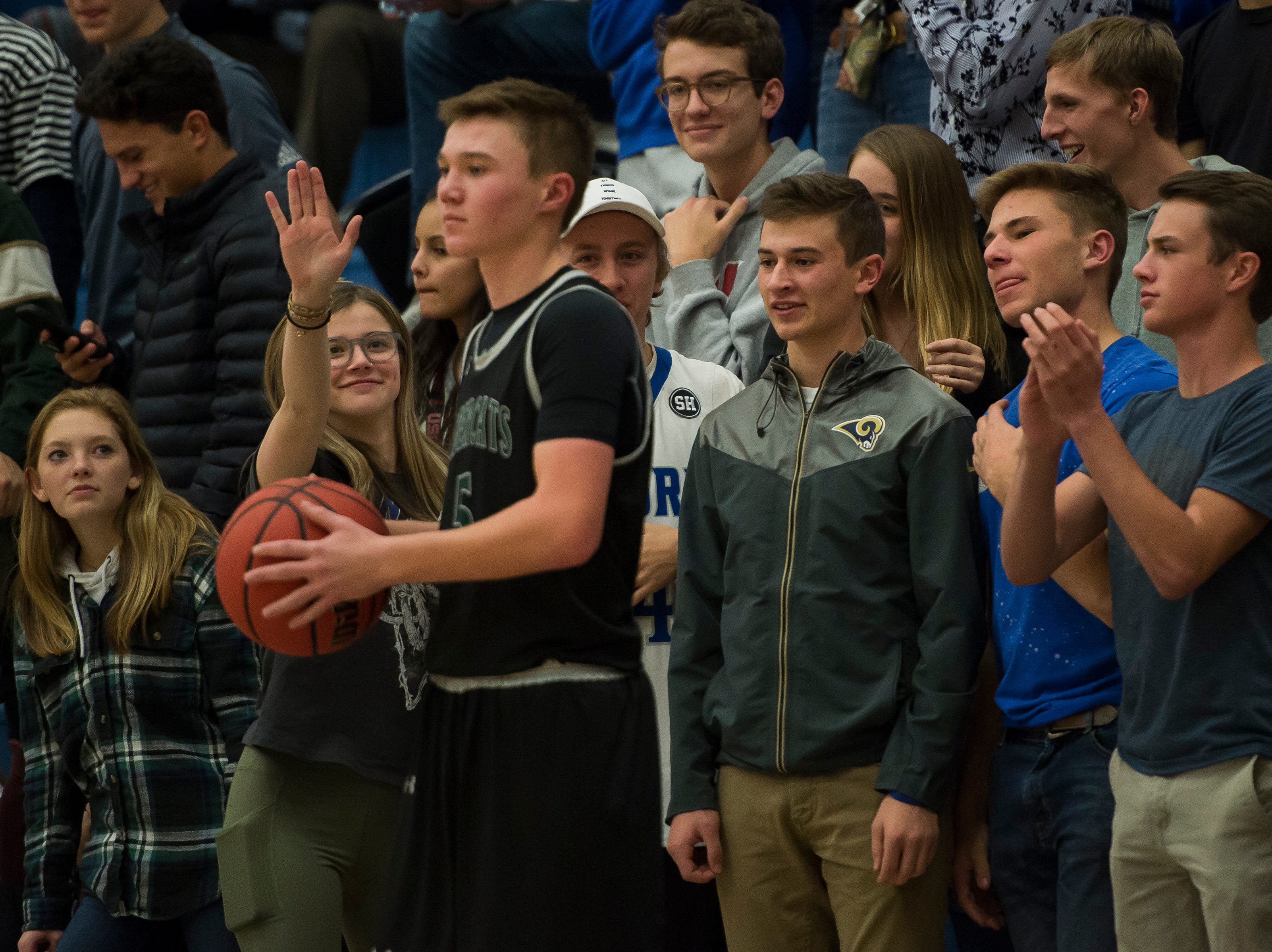 Poudre High School students taunt Fossil Ridge High School sophomore Drew Cornmesser (5) on Tuesday, Dec. 4, 2018, at Poudre High School on Fort Collins, Colo.