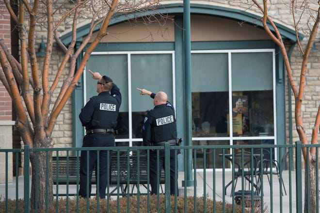 Police search the strip mall where the Chase Bank was robbed on Wednesday, Dec. 5, 2018, at the corner of East Mulberry Street and South Lemay Avenue in Fort Collins, Colo.