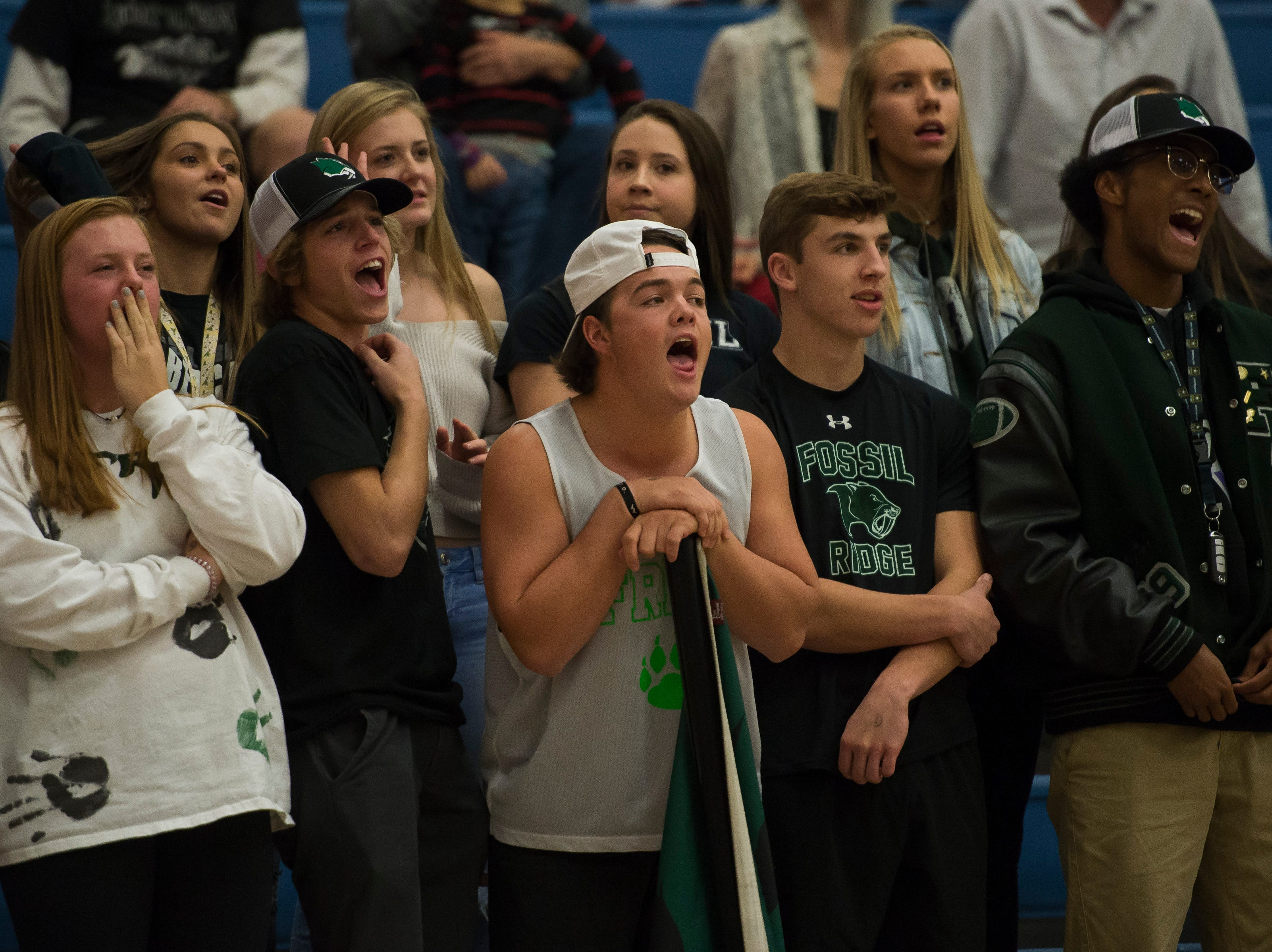 Fossil Ridge High School students attempt to distract a free throw by a  Poudre High School player on Tuesday, Dec. 4, 2018, at Poudre High School on Fort Collins, Colo.