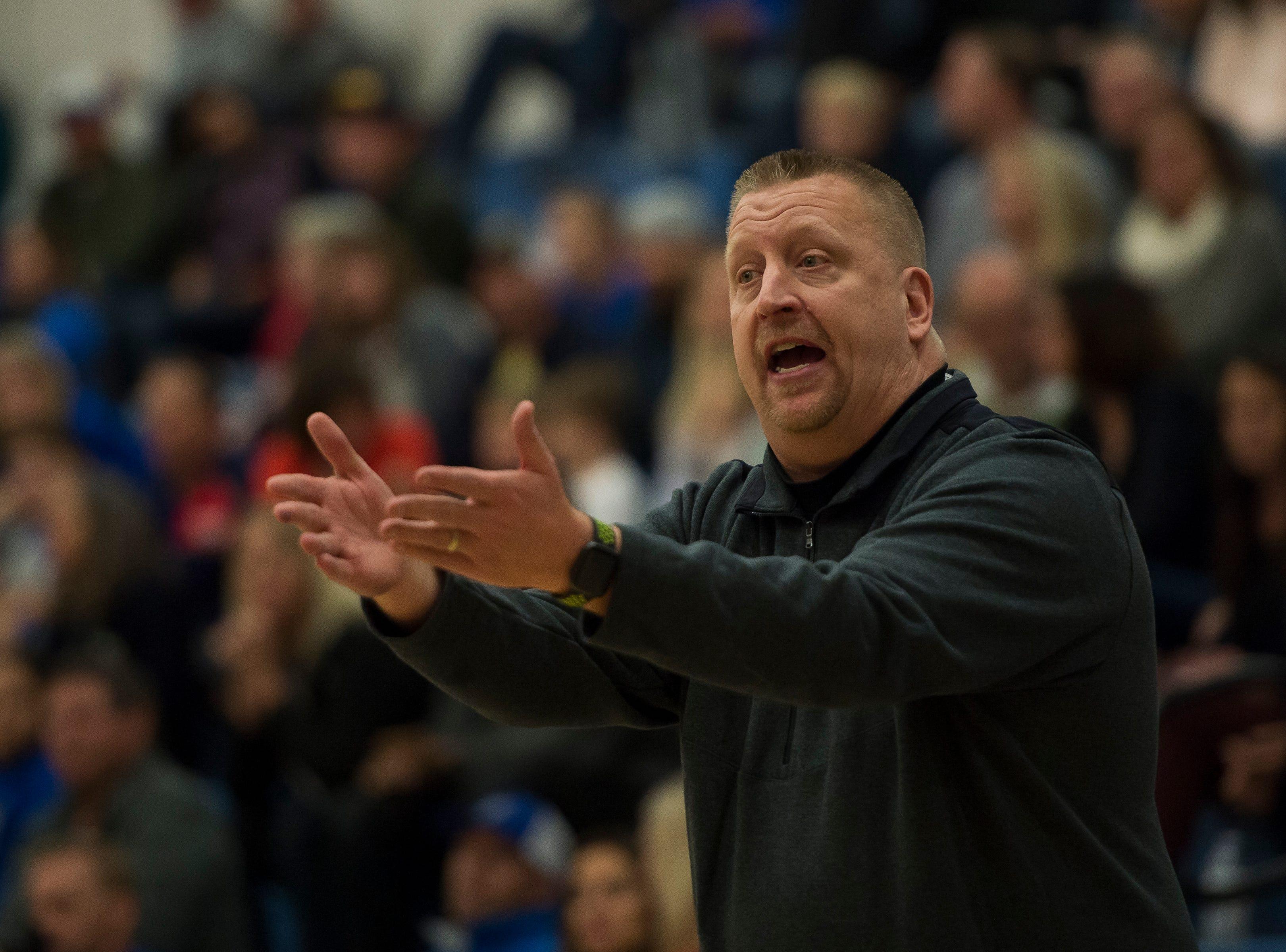 Fossil Ridge High School head coach Matt Johannsen talks to an official during a game against Poudre High School on Tuesday, Dec. 4, 2018, at Poudre High School on Fort Collins, Colo.