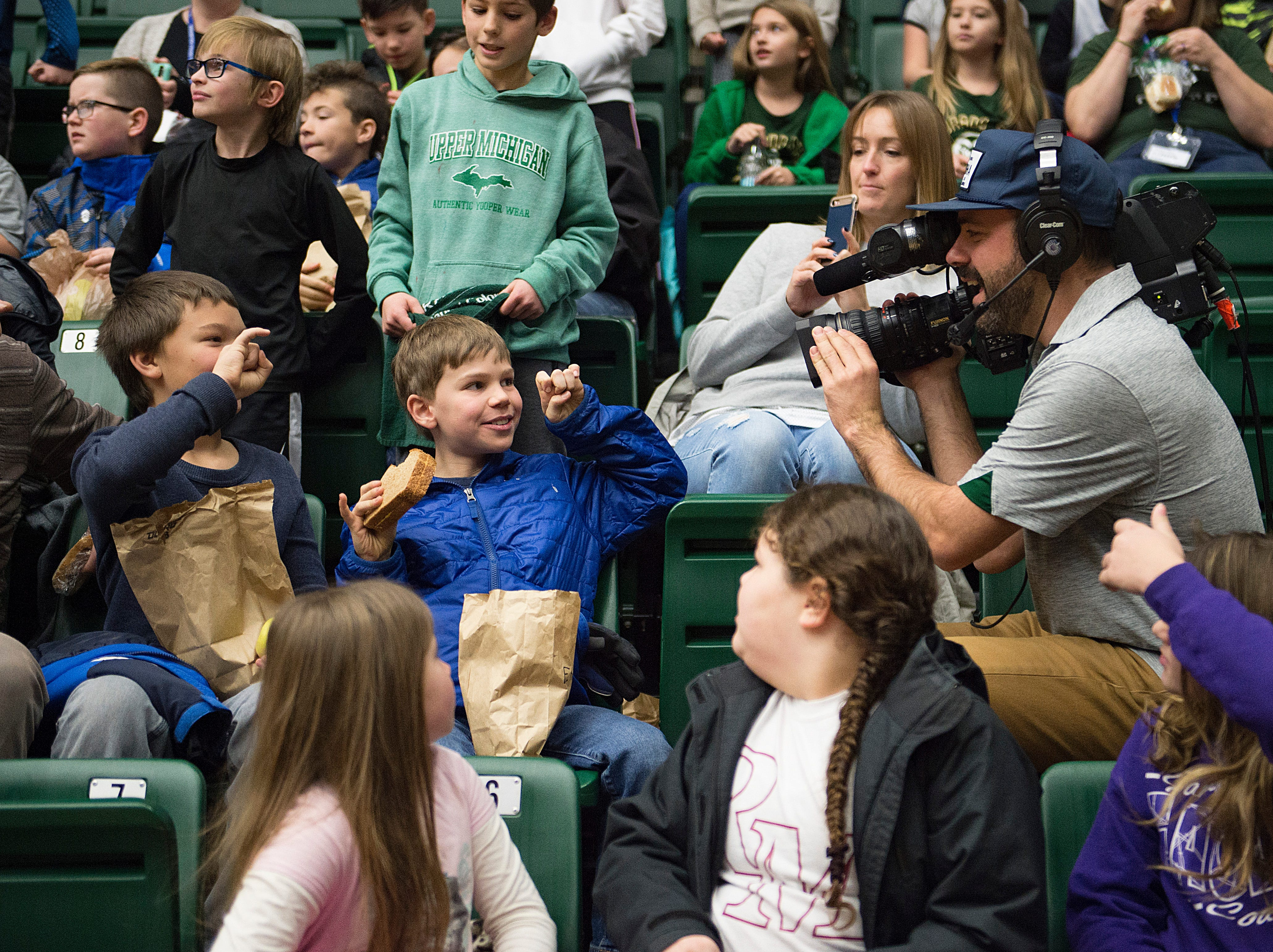 Poudre School District students get some camera time during a CSU women's basketball game against Northern Arizona at Moby Arena on Wednesday, December 5, 2018.