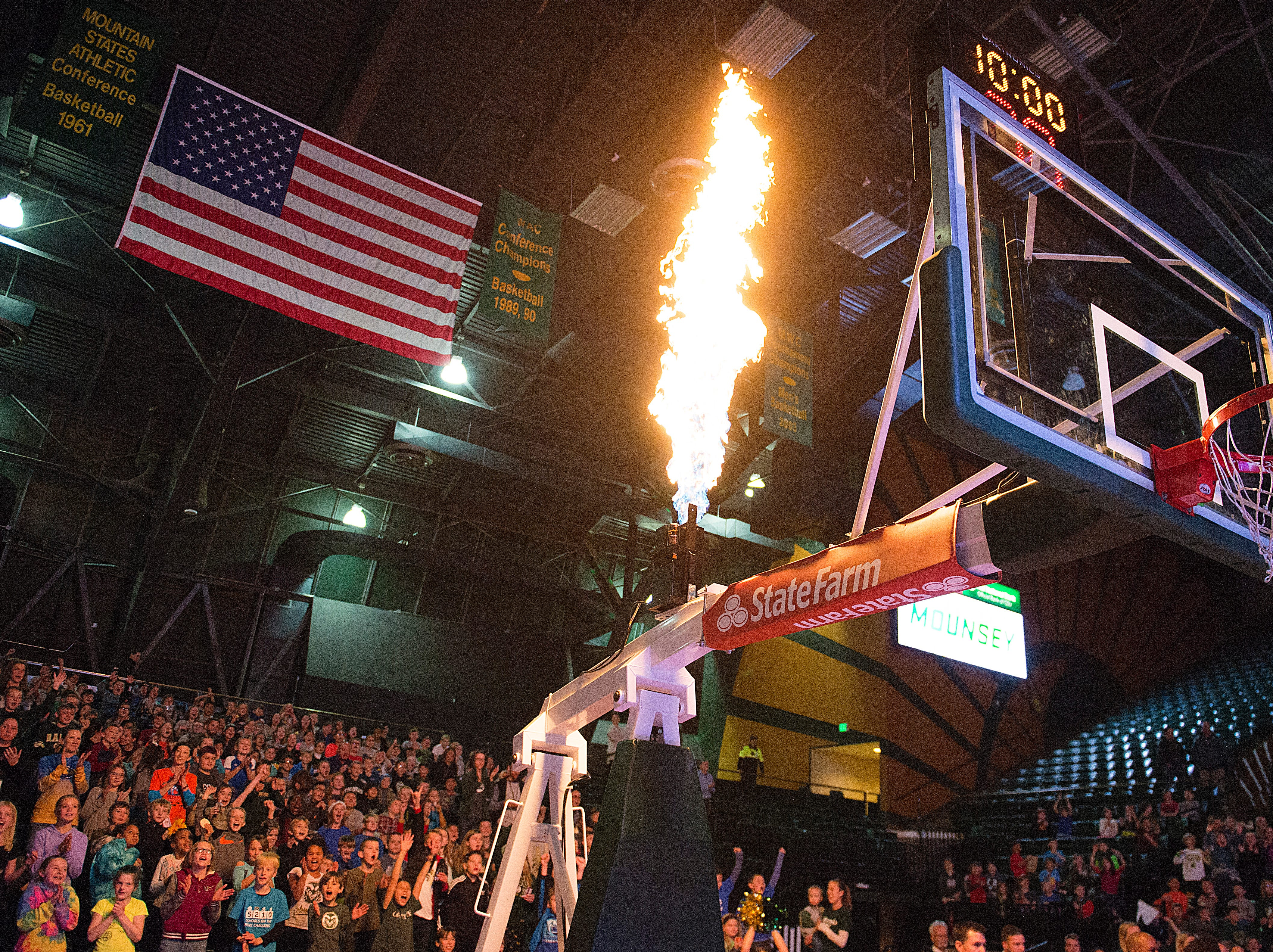 Flames shoot from the basketball hoops before CSU women's basketball takes on Northern Arizona at Moby Arena on Wednesday, December 5, 2018.