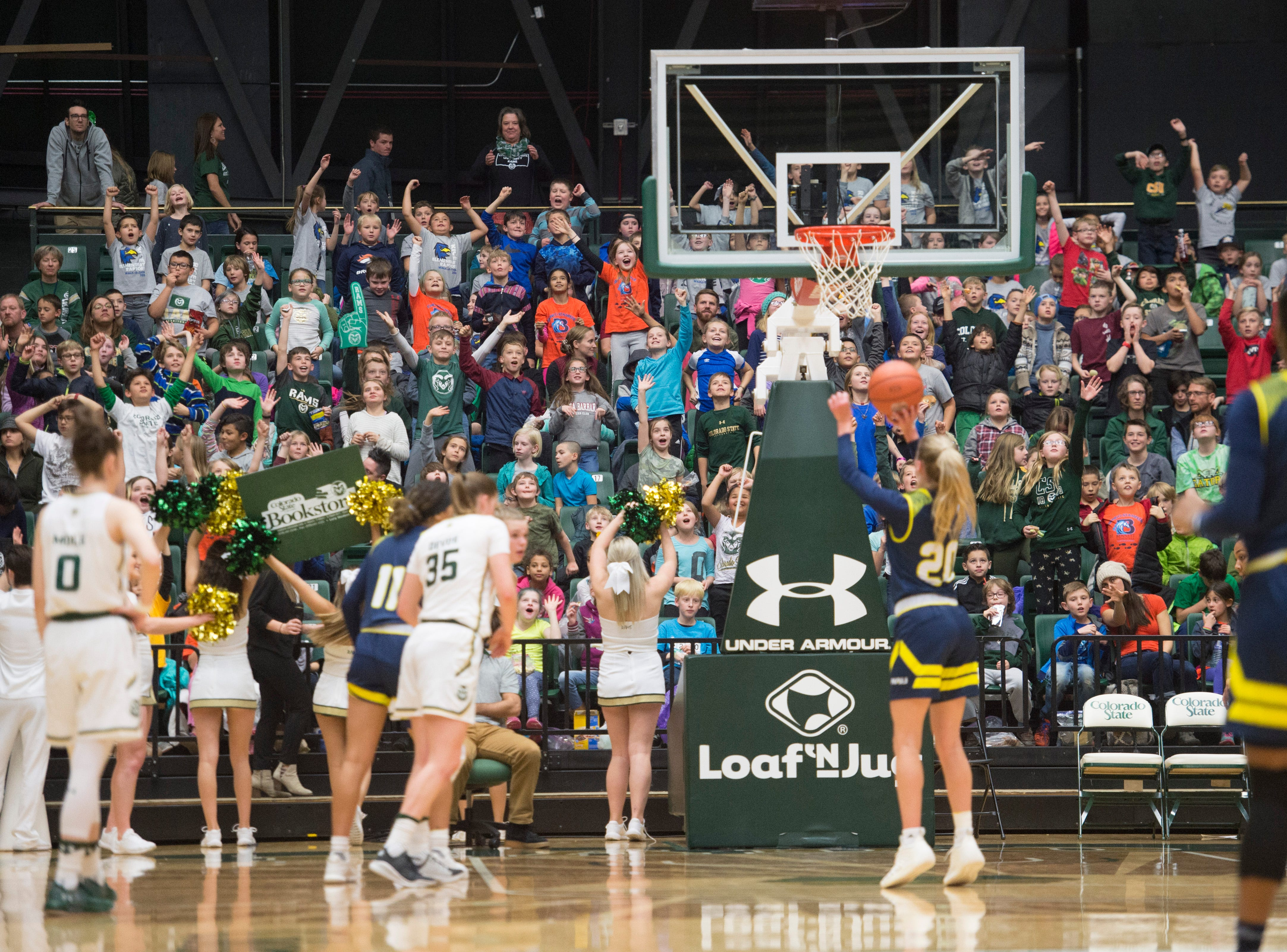 Elementary school students make some noise as Northern Arizona guard Lauren Orndoff shoots free-throws at the line during a game against CSU at Moby Arena on Wednesday, December 5, 2018. 1,600 area elementary school students took some time out of class to cheer on the CSU women's basketball team.