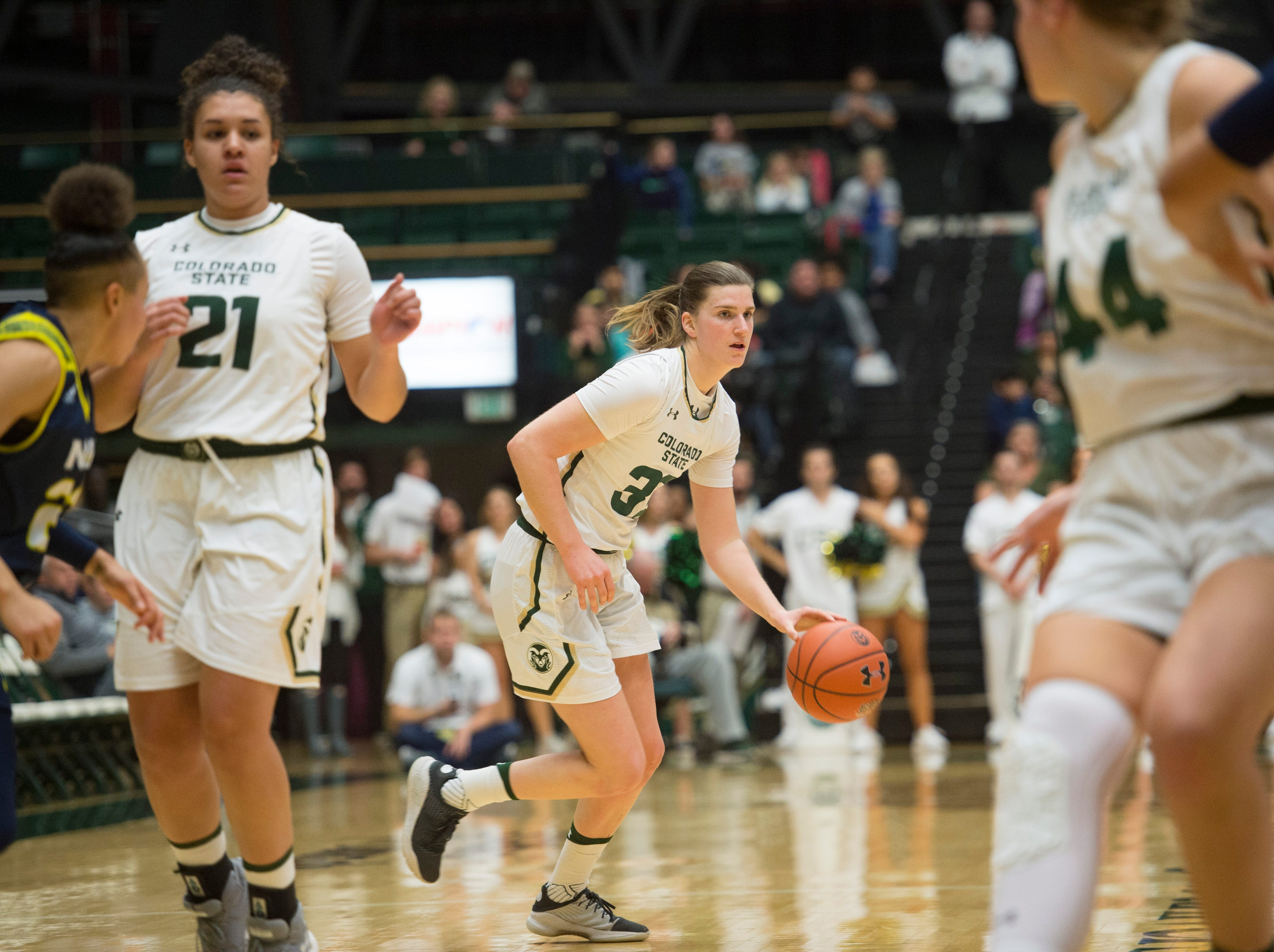 CSU guard Lore Devos tries to find a path through Lumberjacks defense  during a game against Northern Arizona at Moby Arena on Wednesday, December 5, 2018.