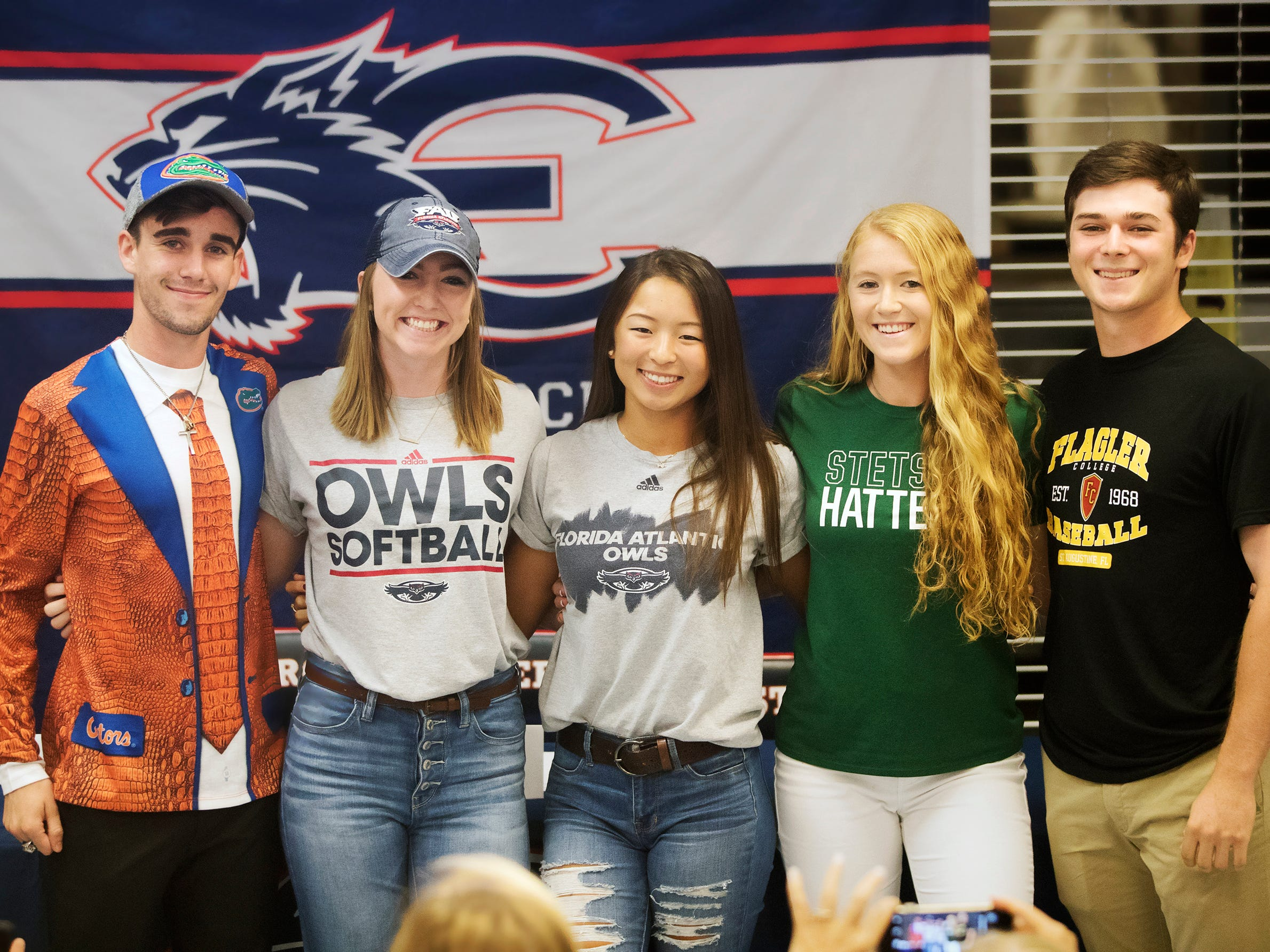 Estero High School athletes Hugh Brittenham, left, Riley Ennis, Kim Egozi, Margaret Struble and Jack Mckee signed letters of intent recently during a National Signing Day event at Estero High School. Brittenham will run track at the University of Florida. Ennis will play softball at Florida Atlantic University. Egozi will play golf at Florida Atlantic University. McKee will play baseball at Flagler College.