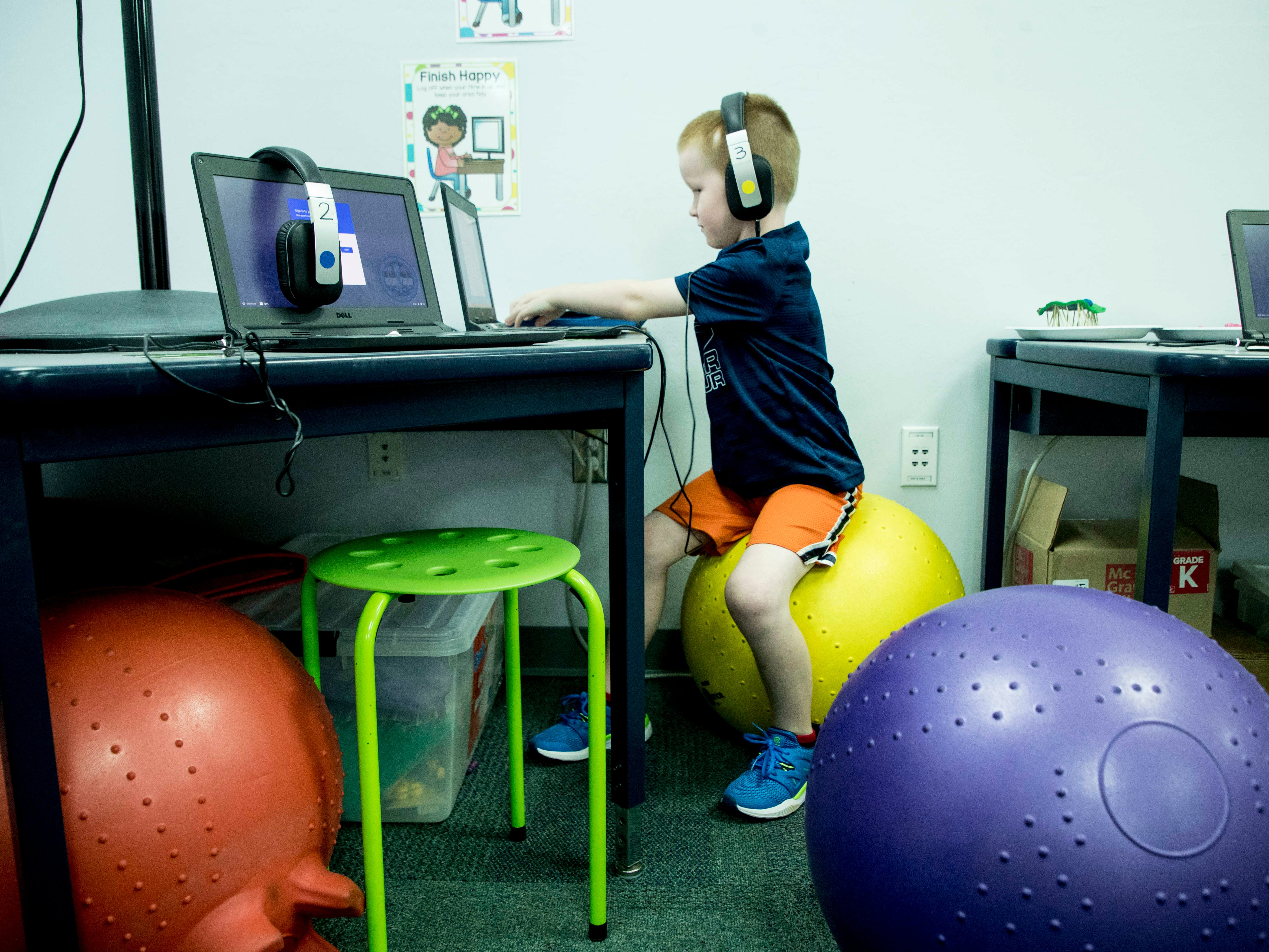 Gulf Elementary kindergartner Evan Hagins,6, sits on a yoga ball while working on a lesson on Monday 12/3/2018. Several classes at the school offers flexible seating to offer students more choices.
