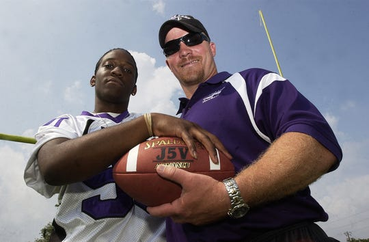 Cypress Lake High School football coach Mark Ivey and player Justin Wilson stand beneath the goal posts on the Panther field in south Fort Myers.