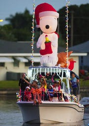 Snoopy makes an appearance at the 2014 Cape Coral's Annual Holiday Boat-A-Long parade at Four Freedoms Park in Cape Coral.