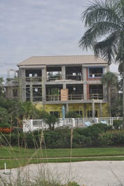 Only the concrete structure of the home on Curacao Lane in Barefoot Beach remains.