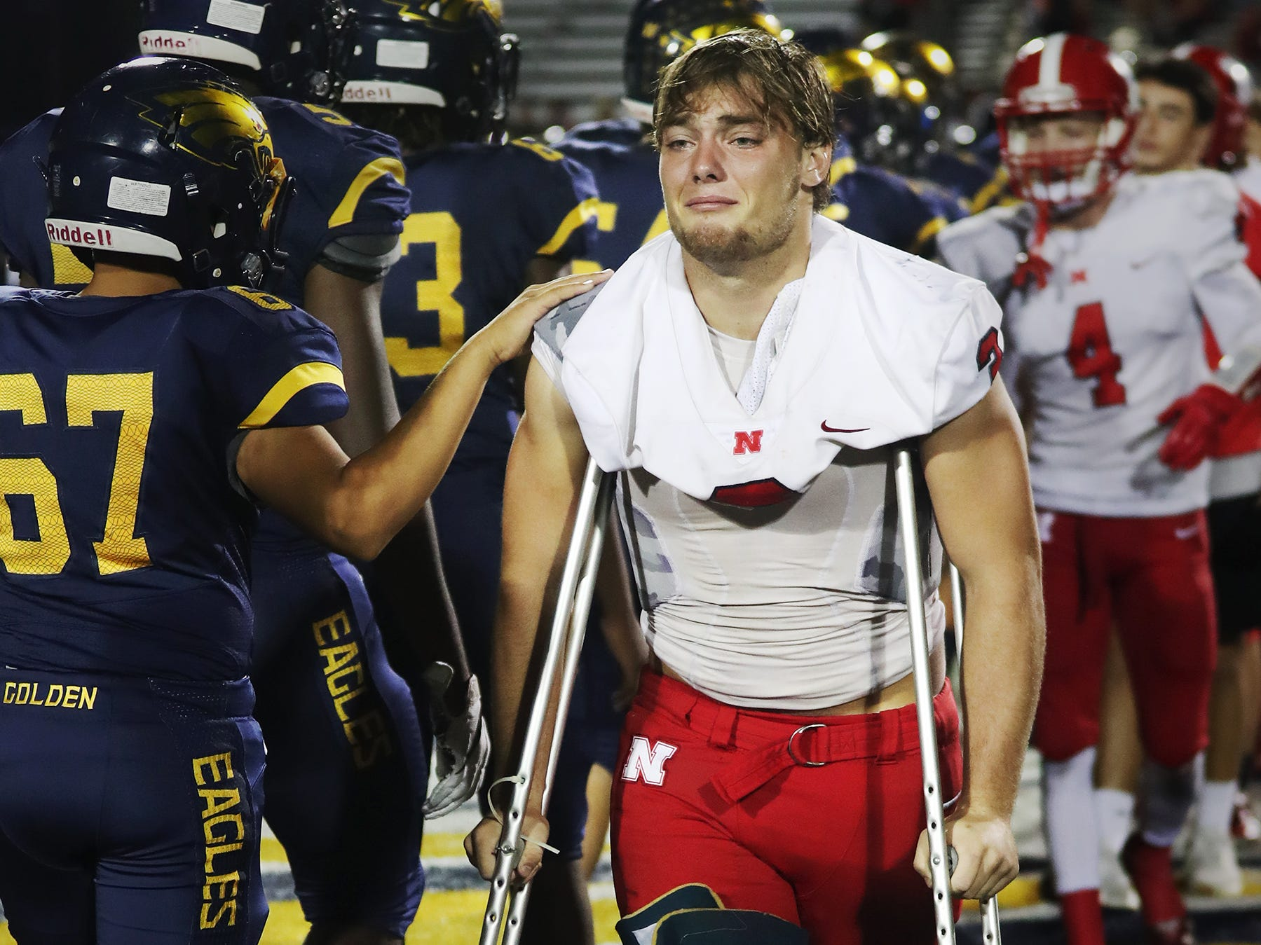 North Fort Myers High School's Hunter Kobylanski leaves the field after losing to Naples recently in the Class 6A regional final at Staver Field in Naples. Naples beat North 23-0. Kobylanski got injured in the first quarter.