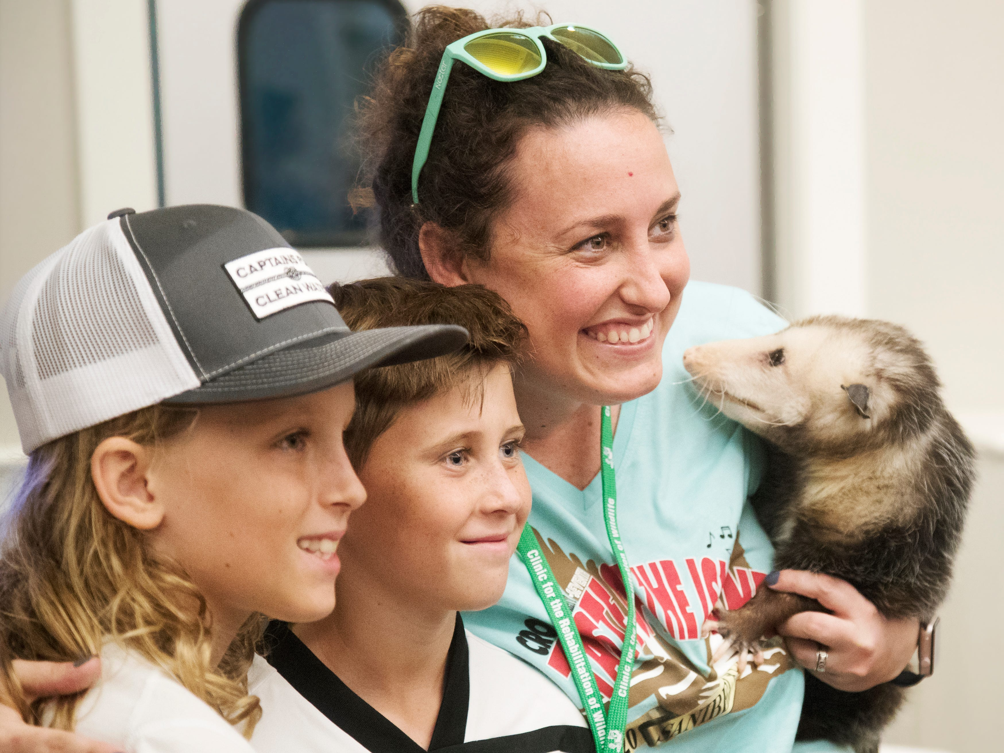 Matthew Huff, 10, left, and Vance Byrd, 10, meet Rachel Rainbolt, of The Clinic for the Rehabilitation of Wildlife (CROW), and Bashful, an opossum recently at the Taste of the Islands event at Sanibel Community Park. The annual event featured food from 13 restaurants and benefits CROW.