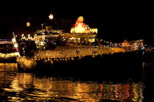 A boat passes by during the 2011 Cape Coral Holiday Boat-A-Long Sunday night at Four Freedoms Park in Cape Coral.