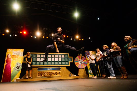 """Wheelmobile host Marty Lublin works the crowd at a Seattle appearance of the """"Wheel of Fortune"""" vehicle."""