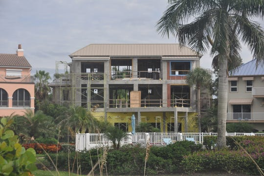 This home on Curacao Lane in Barefoot Beach was gutted and is being rebuilt.