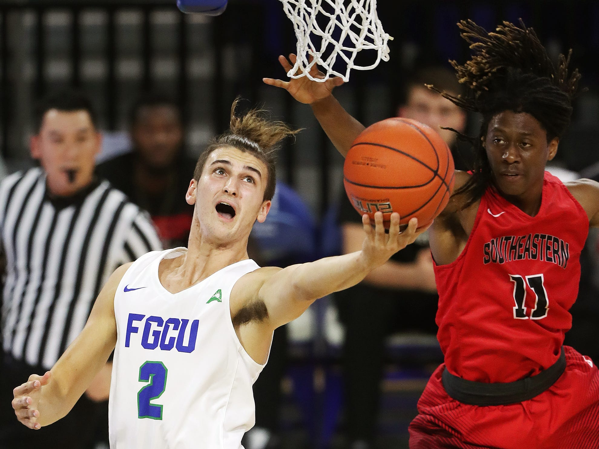 Florida Gulf Coast University's Caleb Catto scores against Southeastern University recently at Alico Arena in Fort Myers. FGCU beat Southeastern 81-54.