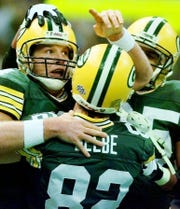 Green Bay Packers quarterback Brett Favre, left, celebrates with teammate Don Beebe (82) after Favre's touchdown during the second quarter of Super Bowl XXXI.