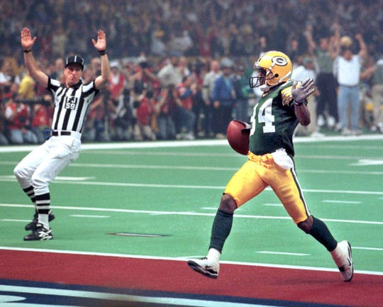 Andre Rison caught a 54-yard touchdown pass early in Super Bowl XXXI.