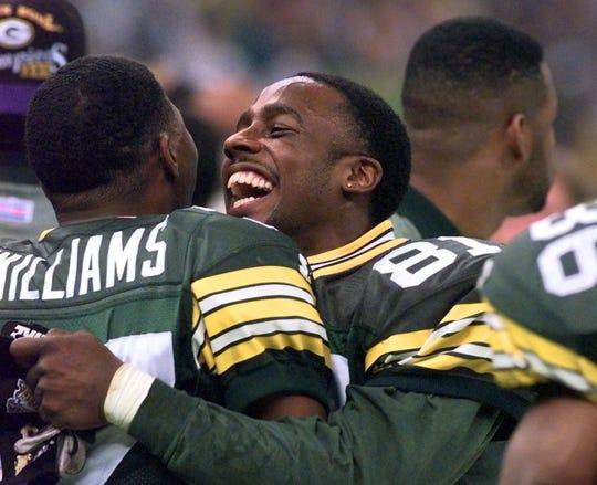 Packers kick returner and Super Bowl MVP Desmond Howard hugs teammate Tyrone Williams after winning Super Bowl XXXI.