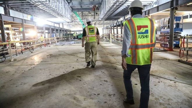 The Jushi plant in Columbia is still under construction but has begun the process to hire 400 workers. The plant will make glass fibers and pellets to be used in the manufacturing of lightweight products.
