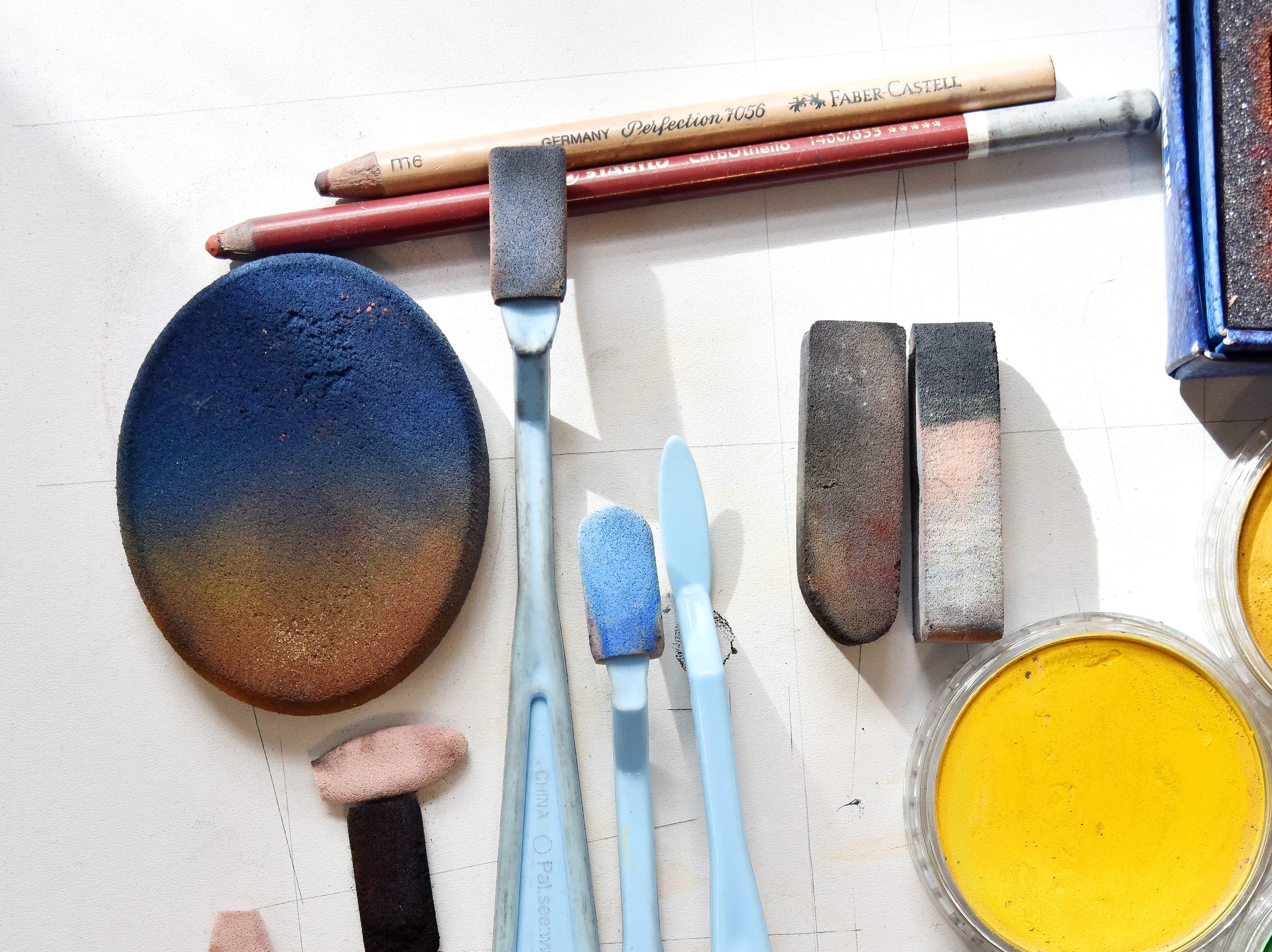 A collection of soft pastels at tools used by artist Olivia White.