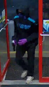 A man suspected of two robberies enters a Spinx convenience store in Greenville County early Wednesday morning.