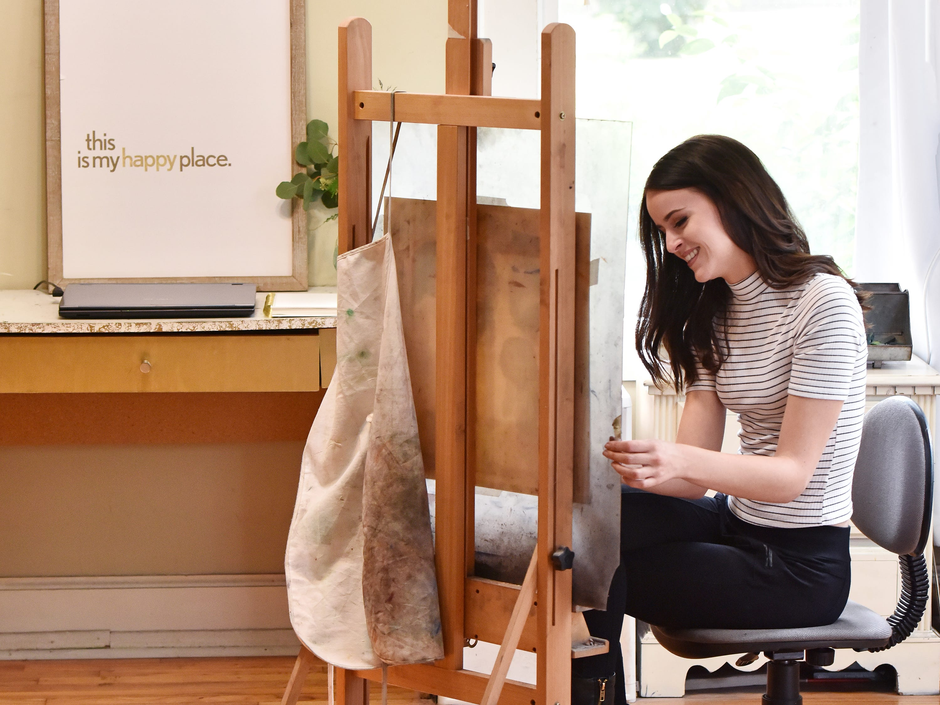 Artist Olivia White works on a pet portrait at her home studio in Anderson.