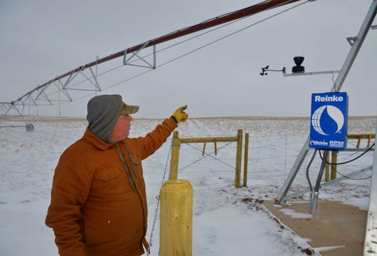 Public Works Director Robin Franzen points out automated weather equipment on a center pivot irrigation system that will automatically shut it down if it starts to rain.