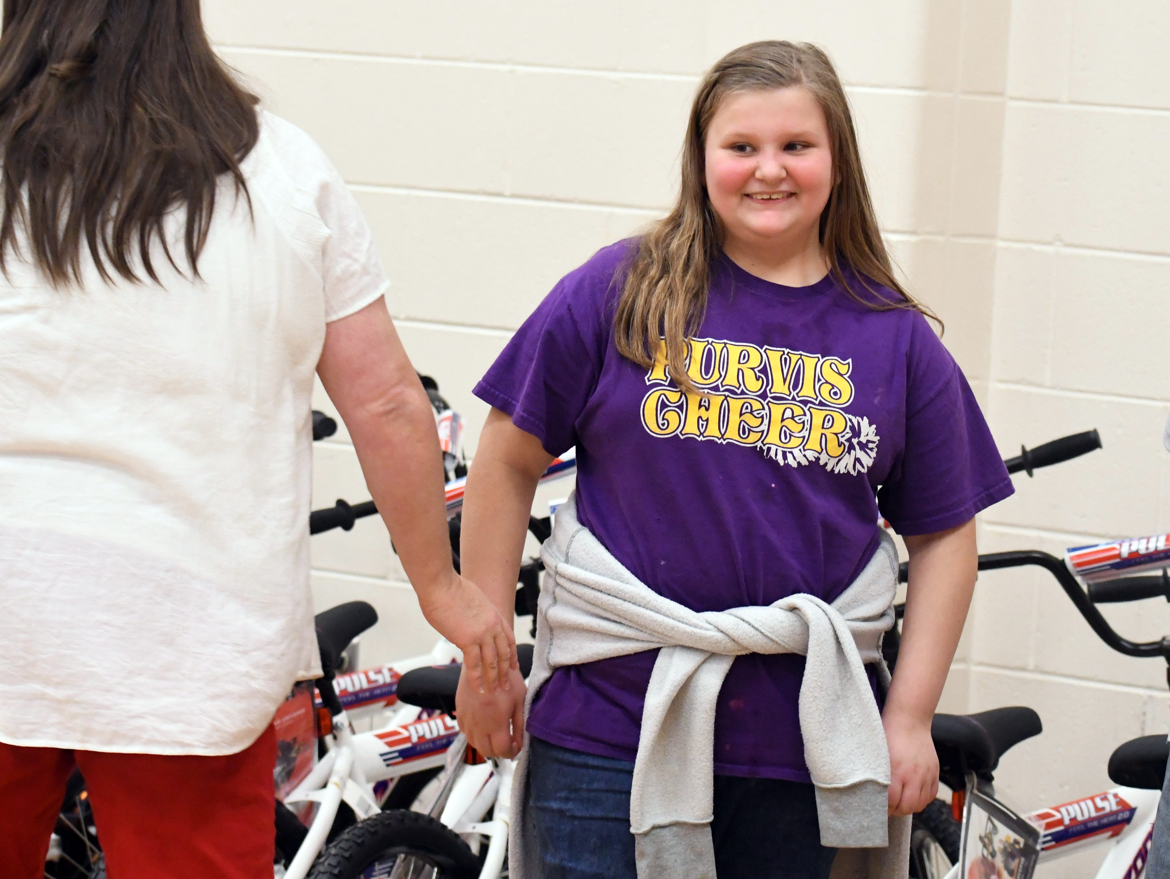 Fifth-grader Elaina James is surprised as she is selected to win a bicycle for her perfect attendance at Purvis Upper Elementary on Wednesday, December 5, 2018. Academy Sports and Outdoors donated 30 bicycles to deserving students to Purvis Upper Elementary as part of its annual bike donation program.