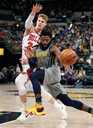 Indiana Pacers guard Tyreke Evans (12) drives on Chicago Bulls forward Lauri Markkanen (24) in the first half of their game at Bankers Life Fieldhouse on Tuesday, Dec. 4, 2018.