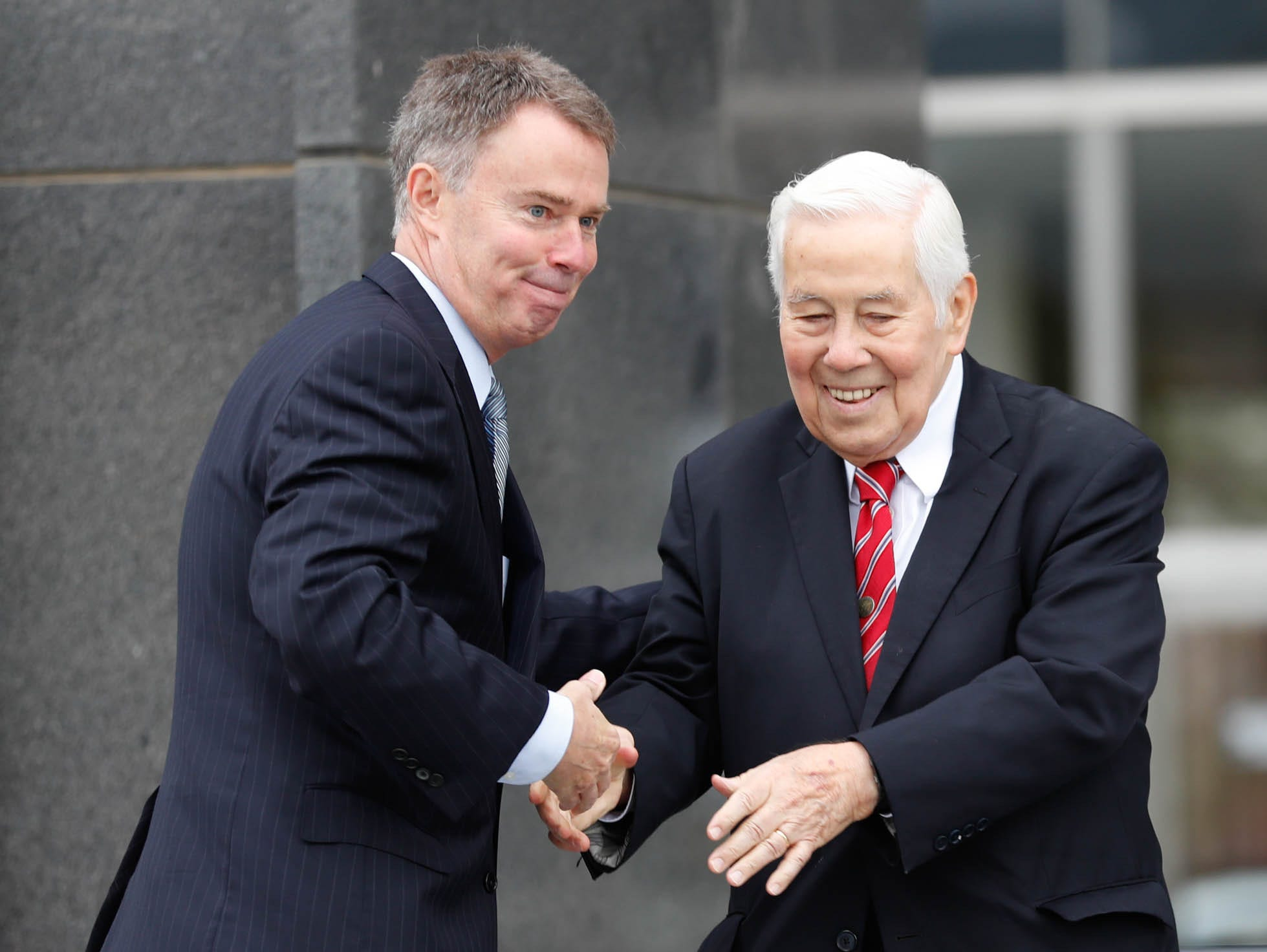 Former Senator and Mayor, Richard Lugar, right, is welcomed to the stage by the current Mayor of Indianapolis, Joe Hogsett, during the reopening and dedication of Richard G. Lugar Plaza at the City-County Building in Indianapolis on Thursday, Oct. 11, 2018.