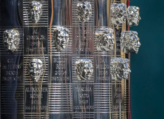 The likeness of Will Power, at bottom right, on the Borg-Warner trophy, Indianapolis Motor Speedway, Wednesday, Dec. 5, 2018. Power is an Australian driver with Team Penske, and is the 105th face on the trophy.
