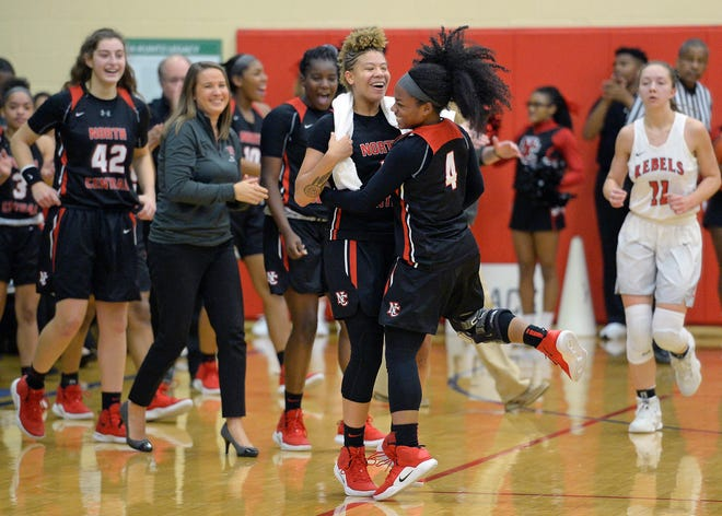 North Central's Rikki Harris (1) celebrates during a time-out after Savaya Brockington (4) had back-to-back plays in the second half of the Marion County tournament at Roncalli High School in Indianapolis, Ind., Tuesday, Dec. 04, 2018. North Central defeated Roncalli 68-50 to advance and play Ben Davis on Thursday.