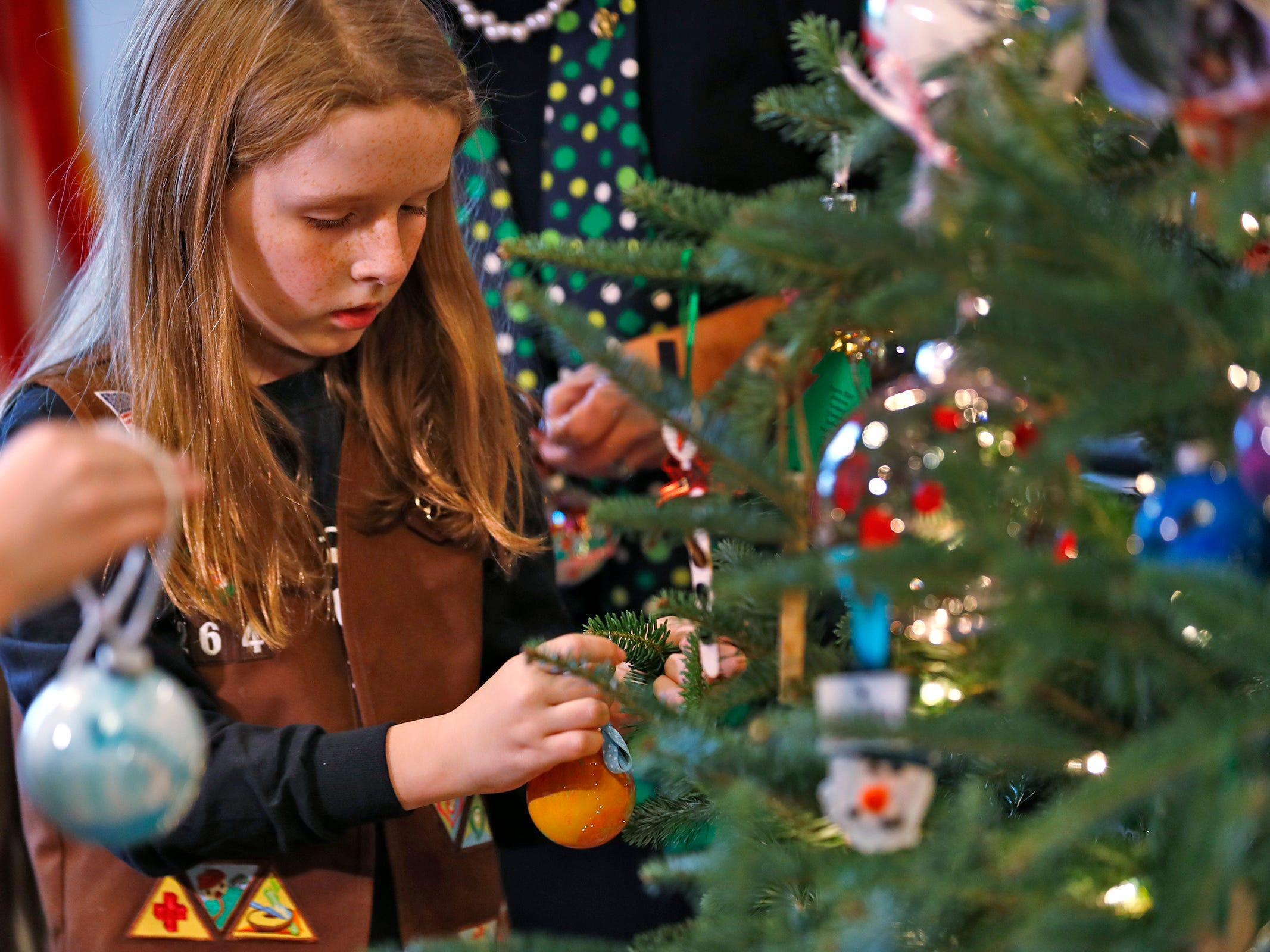 Vivian Bruno and other Brownies join Lieutenant Governor Suzanne Crouch to decorate her Indiana Statehouse tree for the holidays, Wednesday, Dec. 5, 2018.  They used ornaments created by Girl Scouts from across Central Indiana for the tree.