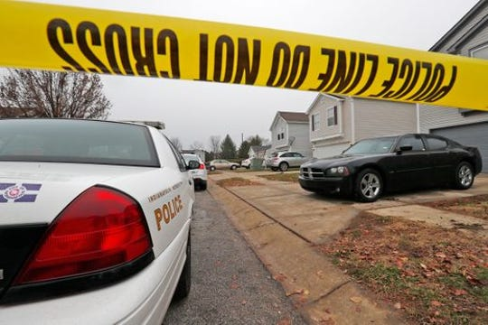 Investigation continues at the scene of a homicide in the 3800 block of Amaranth Court in Indianapolis, Friday, Nov. 30, 2018.