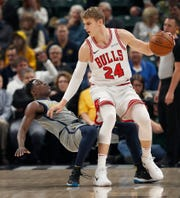 Indiana Pacers guard Darren Collison (2) takes a charge from Chicago Bulls forward Lauri Markkanen (24) in the first half of their game at Bankers Life Fieldhouse on Tuesday, Dec. 4, 2018.