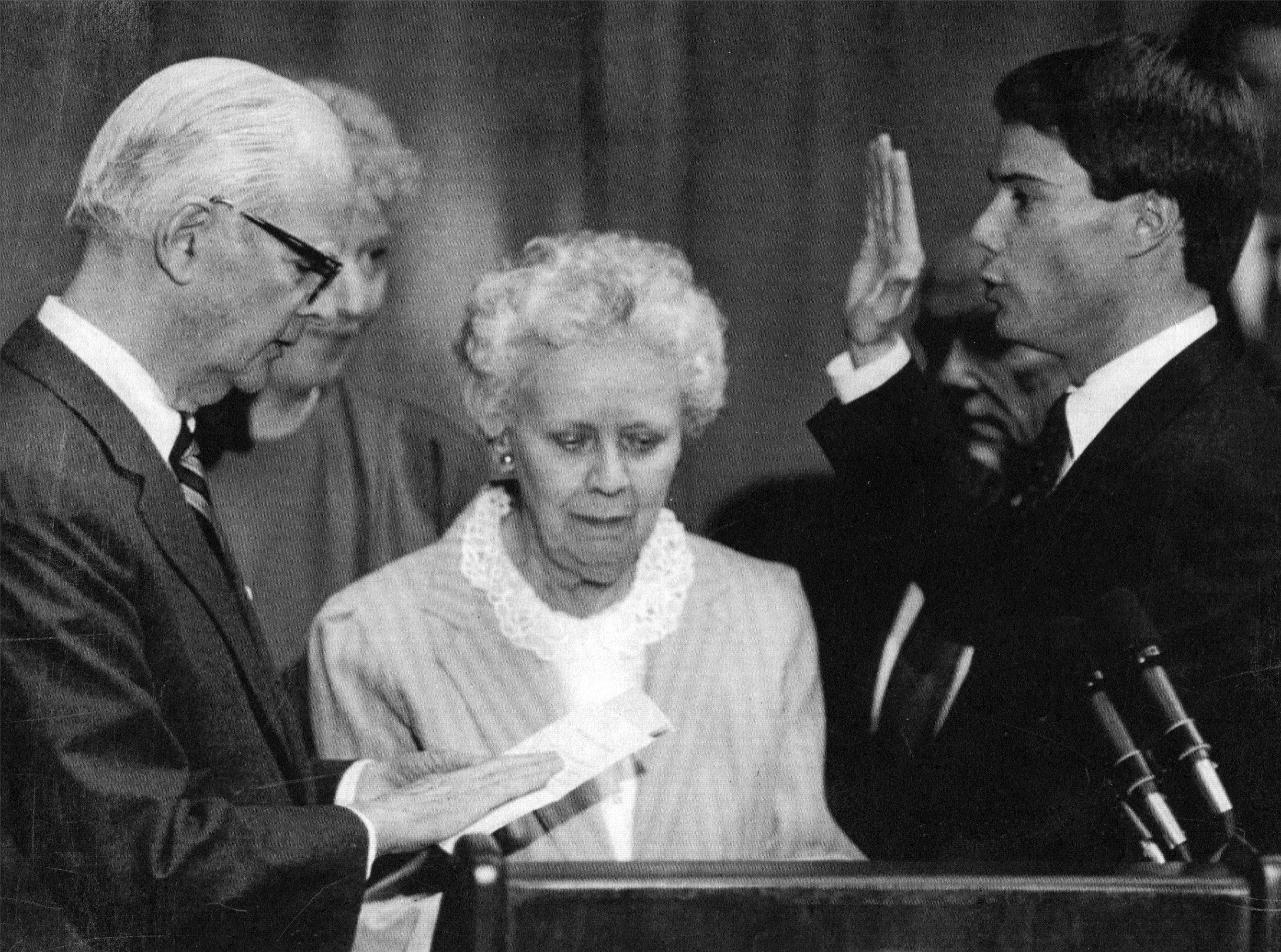 Joe Hogsett, right, takes the oath of office for secretary of state from former Gov. Matthew Welch at the sttehouse in 1989. Hogsett takes over from Evan Bayh.In the middle is Hogsett's mother, Martha.