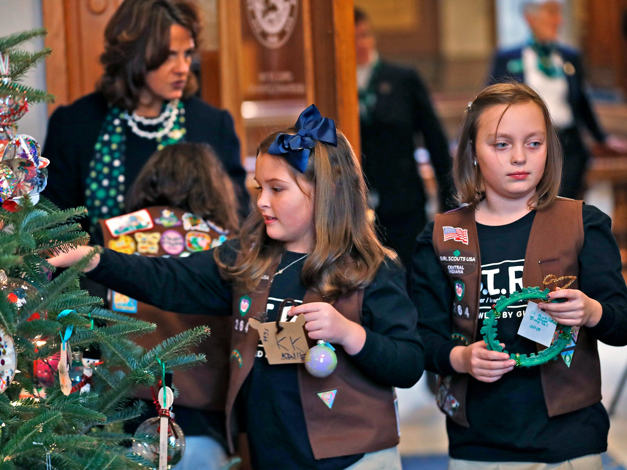 Brownies Katie Callahan and Colette Pardo join Lieutenant Governor Suzanne Crouch to decorate her Indiana Statehouse tree for the holidays, Wednesday, Dec. 5, 2018.  They used ornaments created by Girl Scouts from across Central Indiana for the tree.