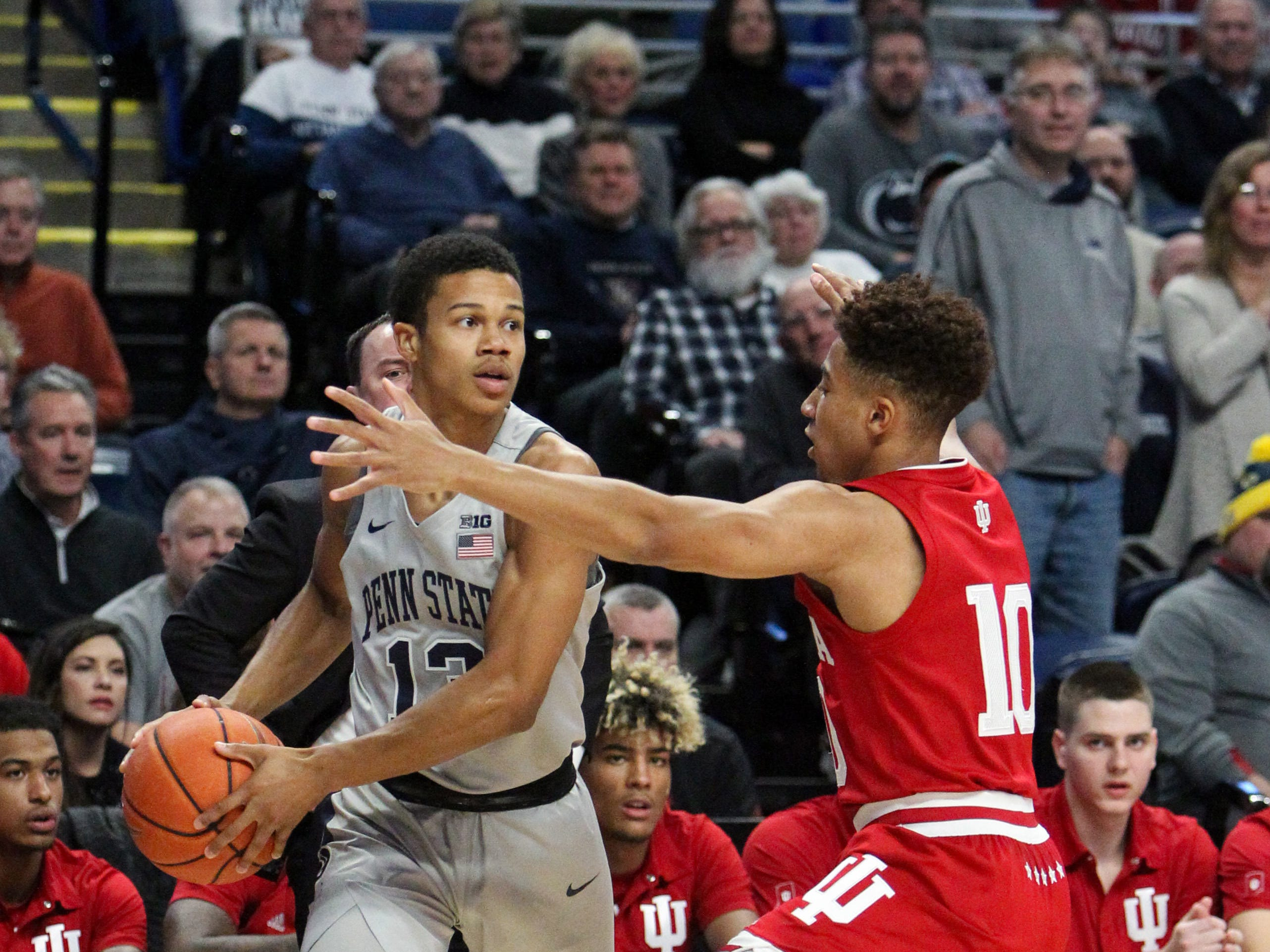 Dec 4, 2018; University Park, PA, USA; Penn State Nittany Lions guard Rasir Bolton (13) controls the ball as Indiana Hoosiers guard Rob Phinisee (10) defends during the first half at Bryce Jordan Center. Mandatory Credit: Matthew O'Haren-USA TODAY Sports