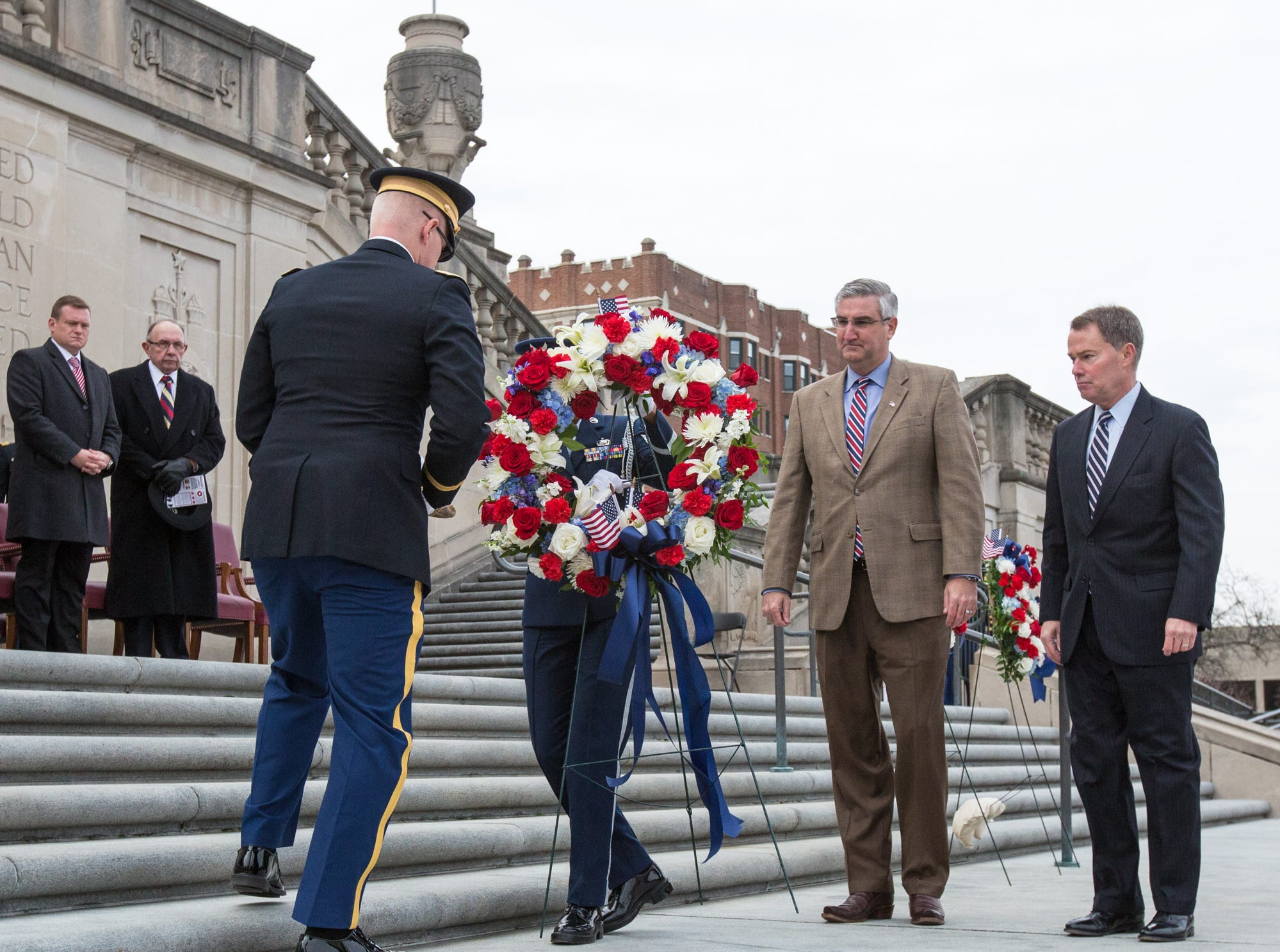Indiana Governor Eric Holcomb and Indianapolis Mayor Joseph Hogsett lay a Victory Wreath on the steps of the Indiana War Memorial, during the Veterans Day Service Saturday, November 11, 2017.